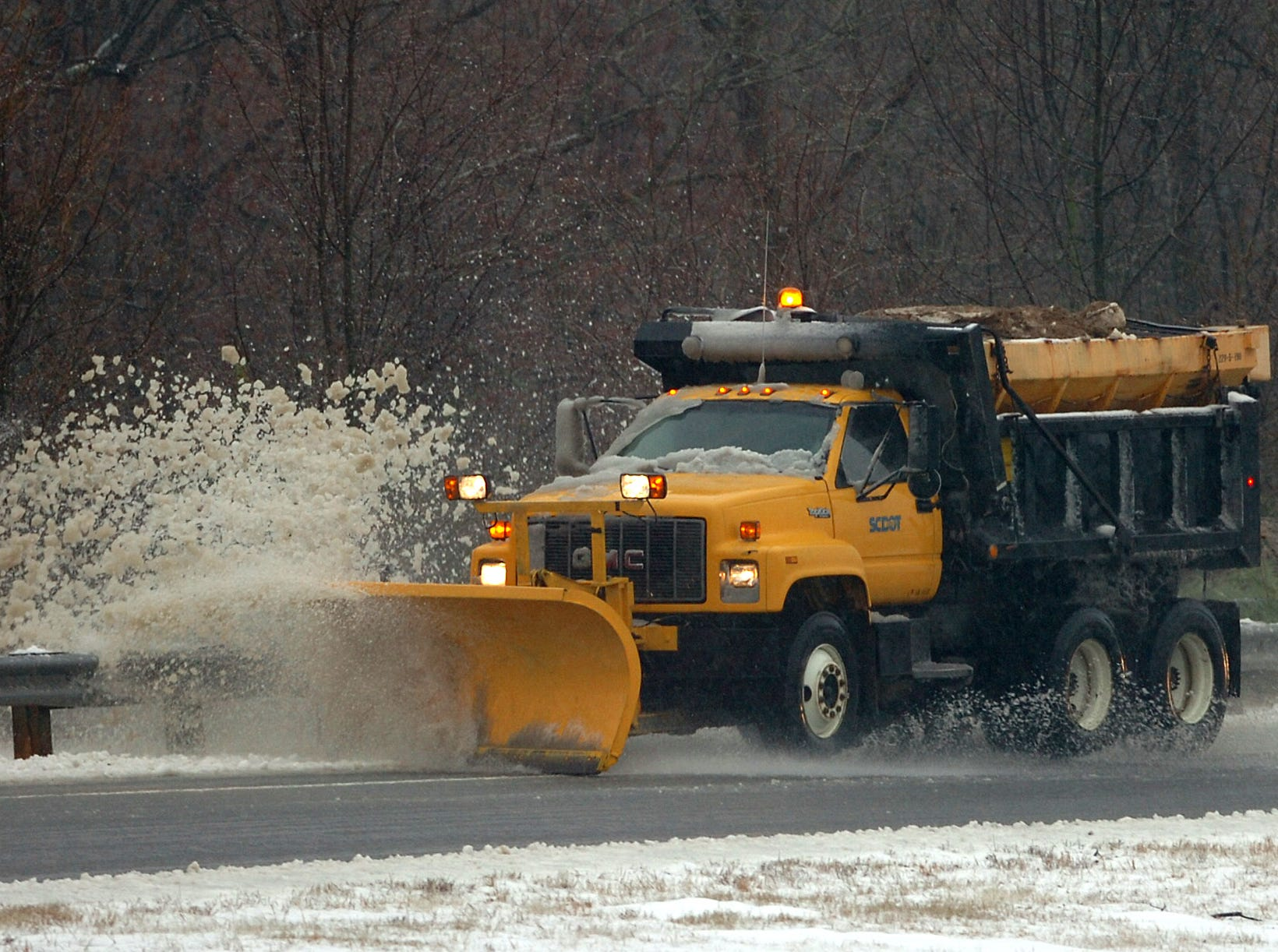 A snow plow clears the exit ramp to Hwy 153 off I-85 in Anderson County Thursday, February 1, 2007.