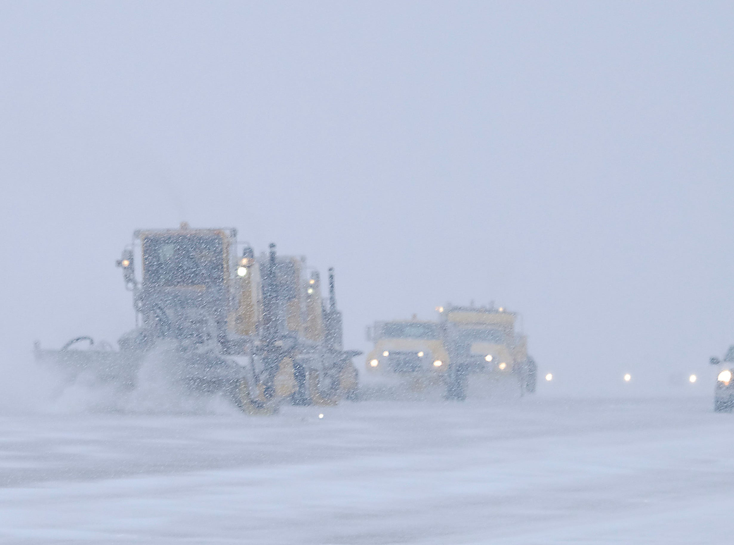 The snow crew at GSP work on keeping the runway clear Thursday, February 13, 2014.