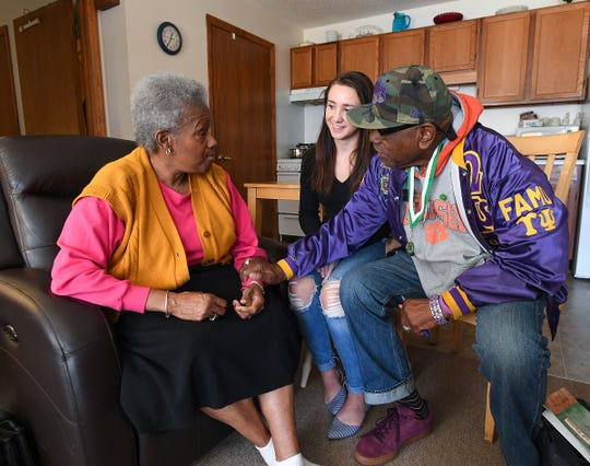 Rev. Dr. Romando James, who is a retired Clemson professor and the founder of a nonprofit dealing with youth, along with his research assistant Rachel Windser, meet with Betty Watson at her home in Woodruff Thursday, December 4, 2018. James wrote about Watson is being inducted into the National 4H Hall of Fame.