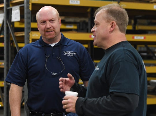 Brothers Jeff, left, and Todd Halloran talk about their family owned business Knife Source at the factory in Ft. Inn Thursday, December 4, 2018.
