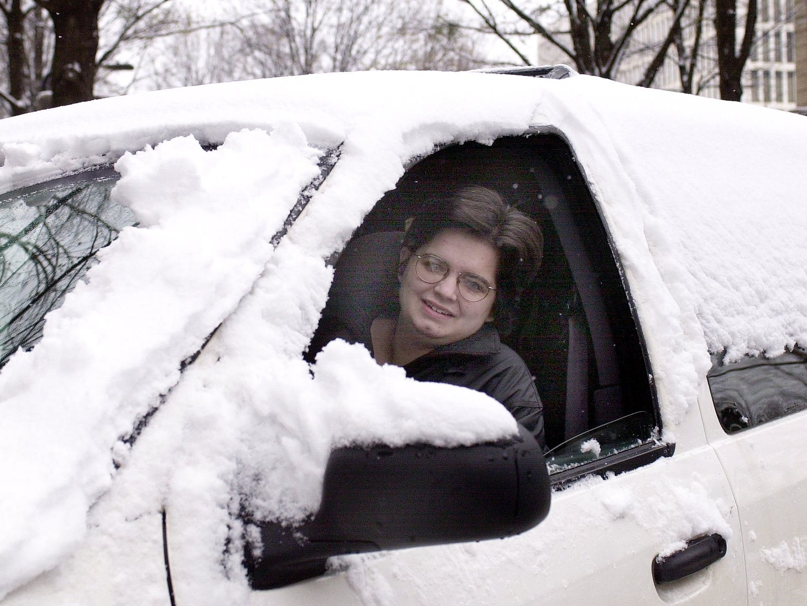 Anna Greeg gets ready to head home after clearing snow from her vehicle parked on Main St. January 3, 2002.
