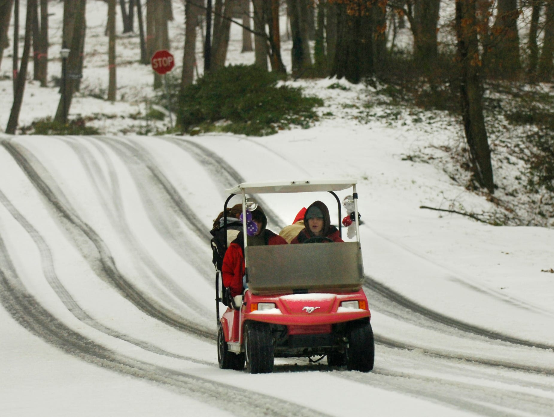 A golf cart turned into a snowmobile as it made its way up Botany Road in Greenville's  Botany Woods neighborhood early Thursday, February 1, 2007.