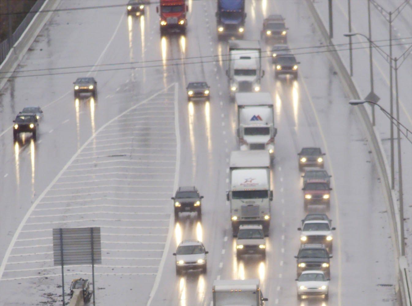 Snow plows spred salt on south bond I-85 Saturday Jan 29, 2000.