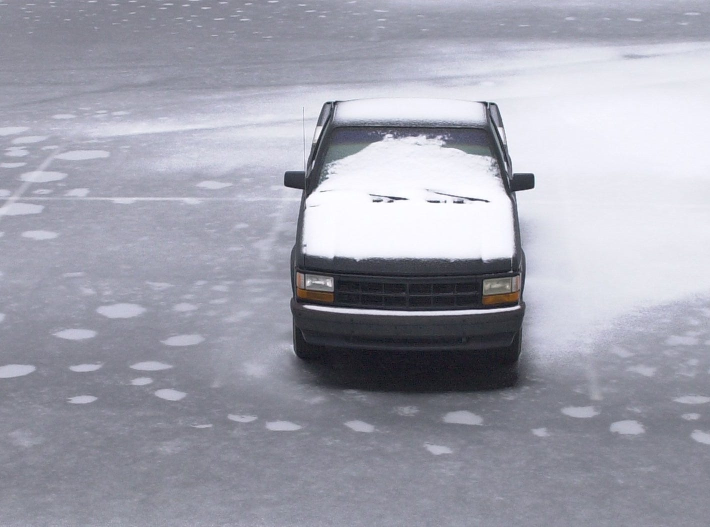 A snow and ice encrusted pickup parked by itself on the ice covered parking lot at County Square in Greenville January 29, 2005.