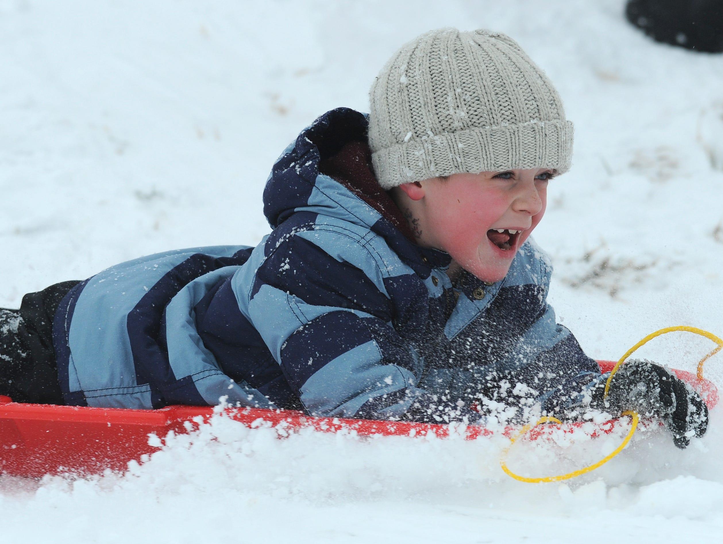 Boyd Maynard sleds in Belton Wednesday, February 12, 2014.