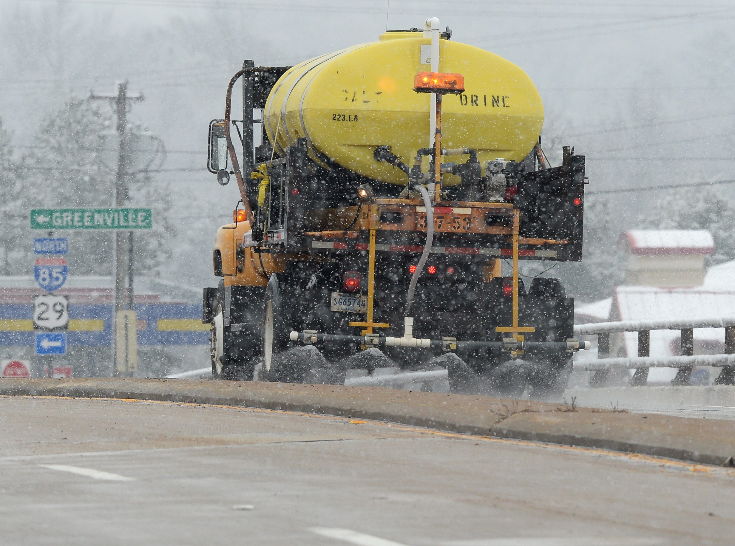 A South Carolina DOT truck spreads salt on a bridge over I-85 in Anderson County Tuesday, February 11, 2014.