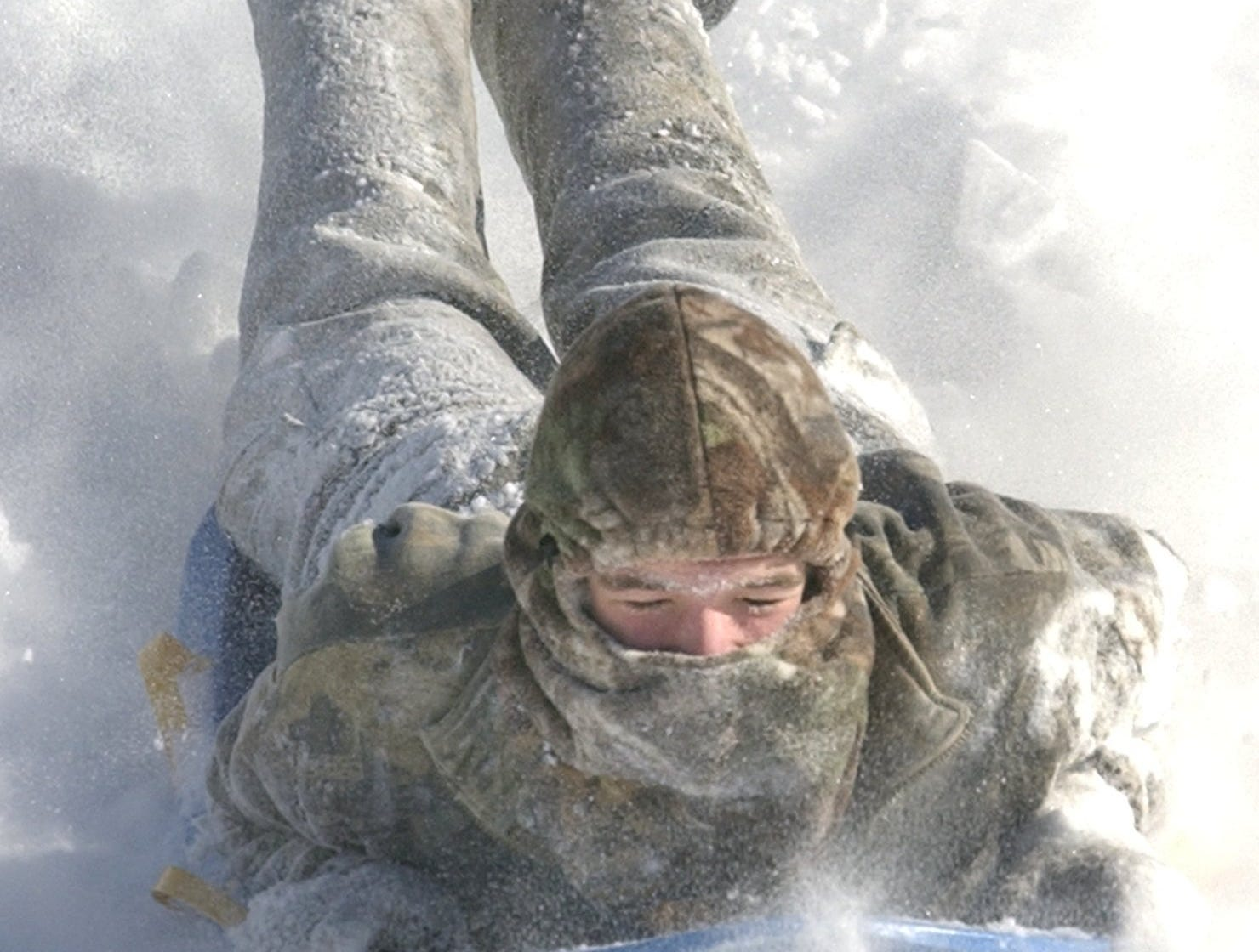 At Bob Jones University: BJU Academy student Tim Davis, 17, enjoys some serious sledding Thursday morning. Davis and other academy students had a day off because of the snow January 23, 2003.