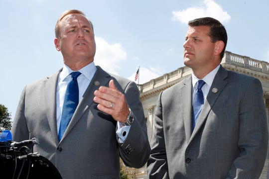 In this Wednesday, May 9, 2018 file photo, Rep. Jeff Denham, R-Calif., left, speaks next to Rep. David Valadao, R-Calif., during a news conference on Capitol Hill in Washington. The Republican incumbents were swept out of office in 2018 after a tally of late-arriving ballots.