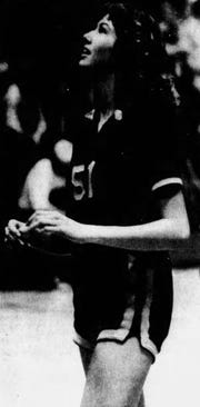 Holly Bertus competes in the State A basketball tournament at Shelby High School in 1979. The Golden Eagles defeated Glendive for the title 41-31.