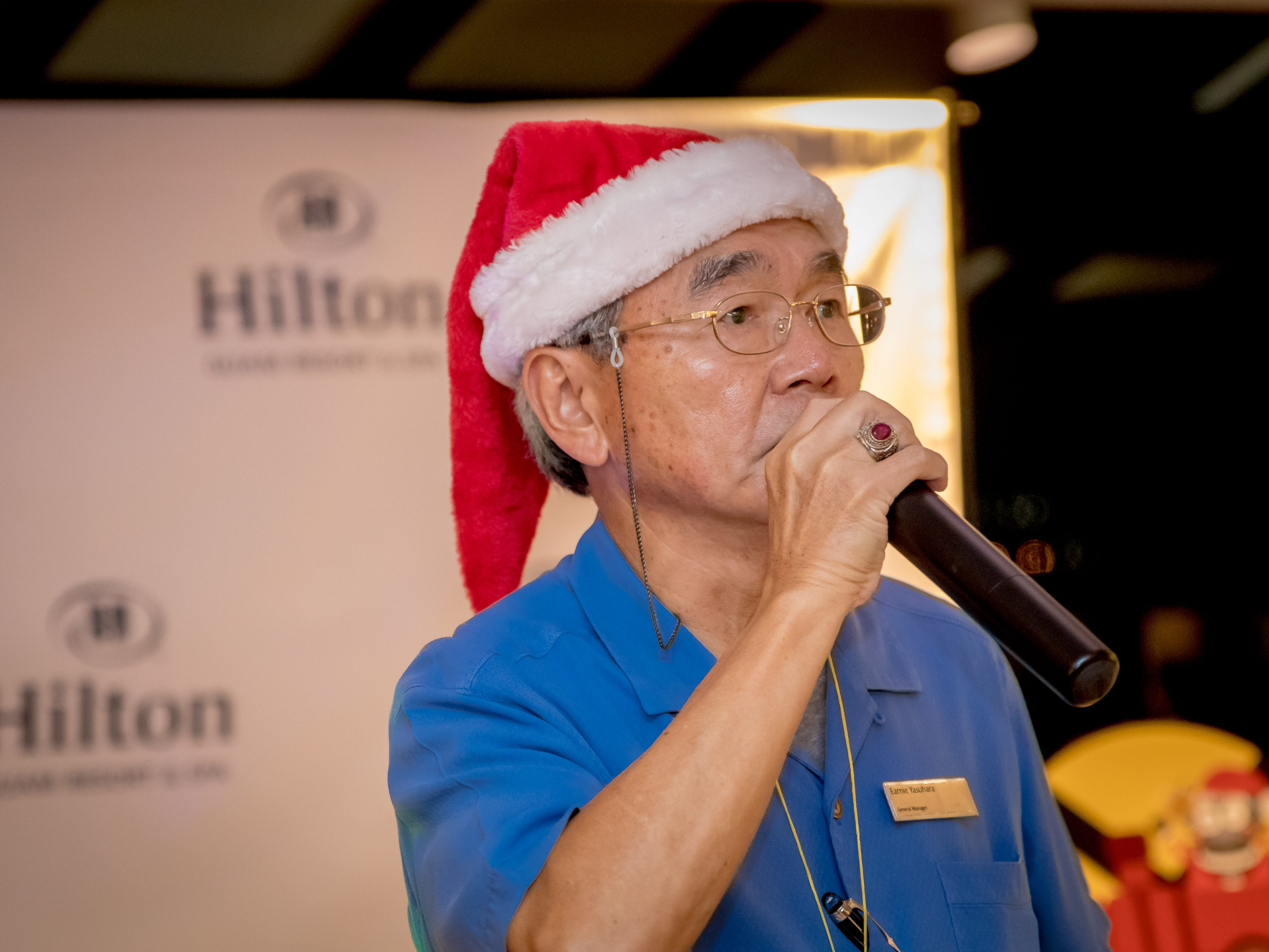 "Makoto ""Earnie"" Yasuhara, general manager of Hilton Resort and Spa Guam speaks to guests during the launching of their annual Holiday Train display at their hotel lobby on Dec. 5."