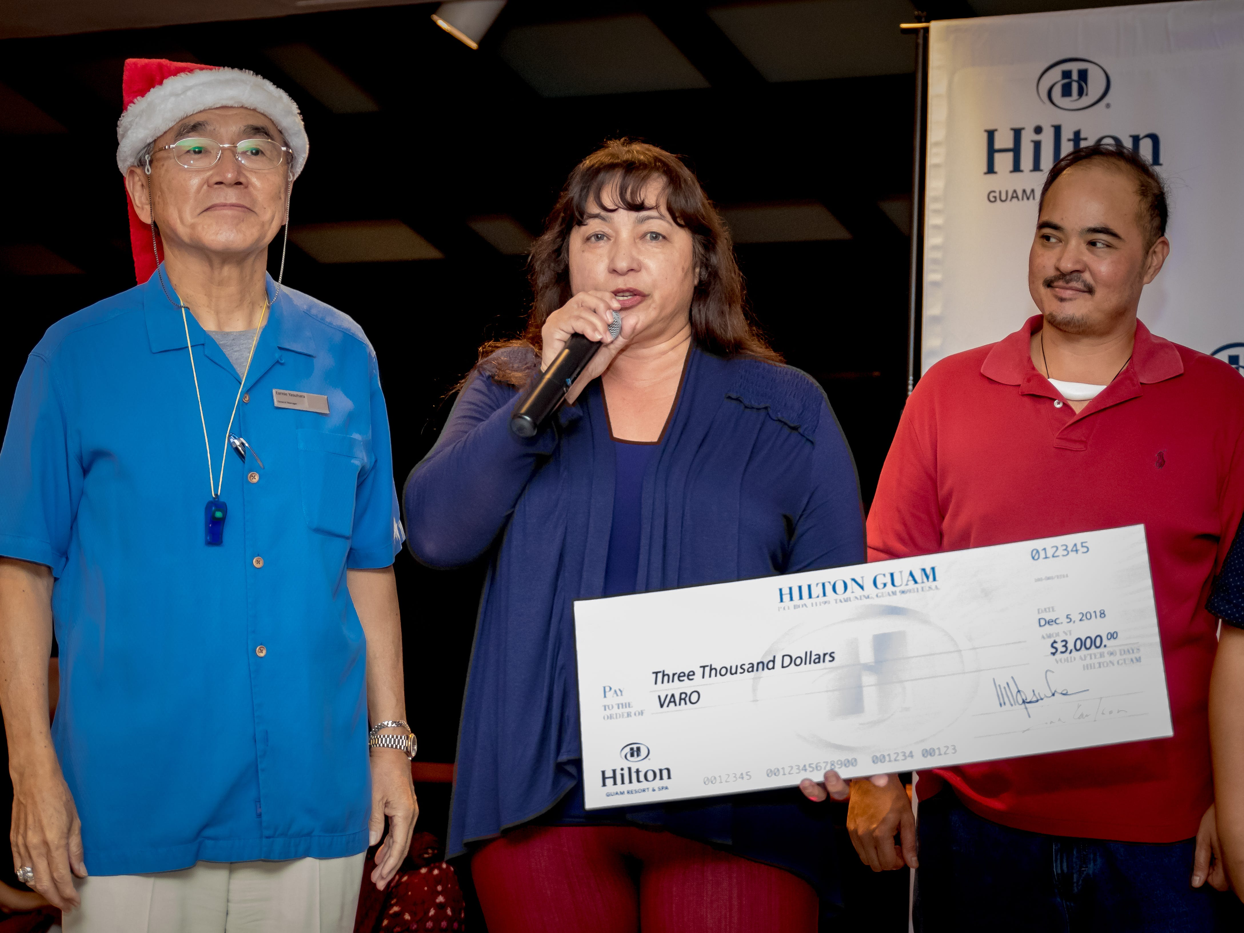 Hilton Guam Resort and Spa presents a check to Victim Advocates Reaching Out during the launching of Holiday Train display at the Hilton Guam Resort and Spa on Dec. 5.