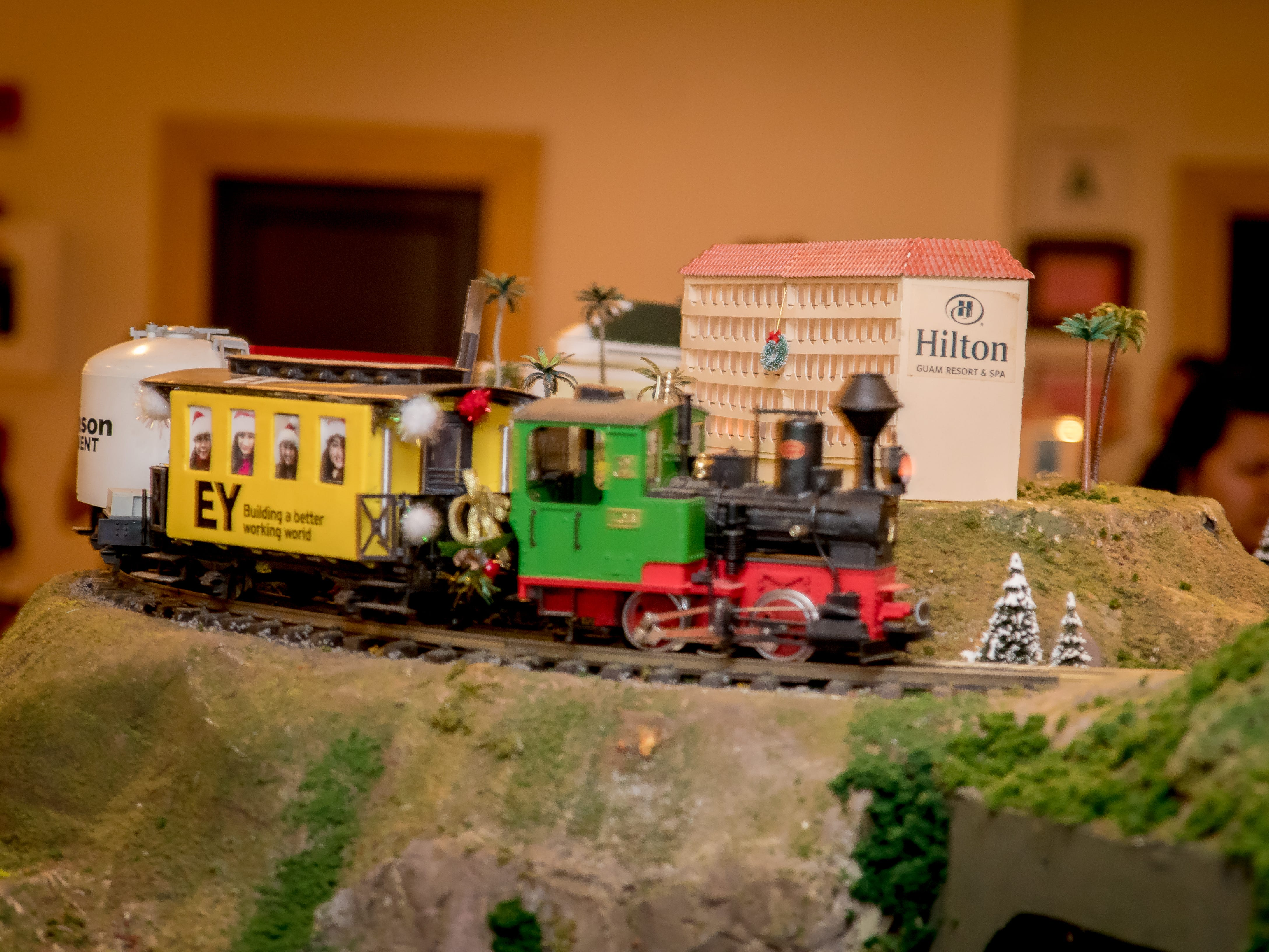 "Hilton Guam Resort and Spa transforms their lobby displaying train sets, miniature local sites, train landscapes, and advertising from local companies .  Sponsorship at the ""Holiday Train"" benefits a local charity Victim Advocates Reaching Out."