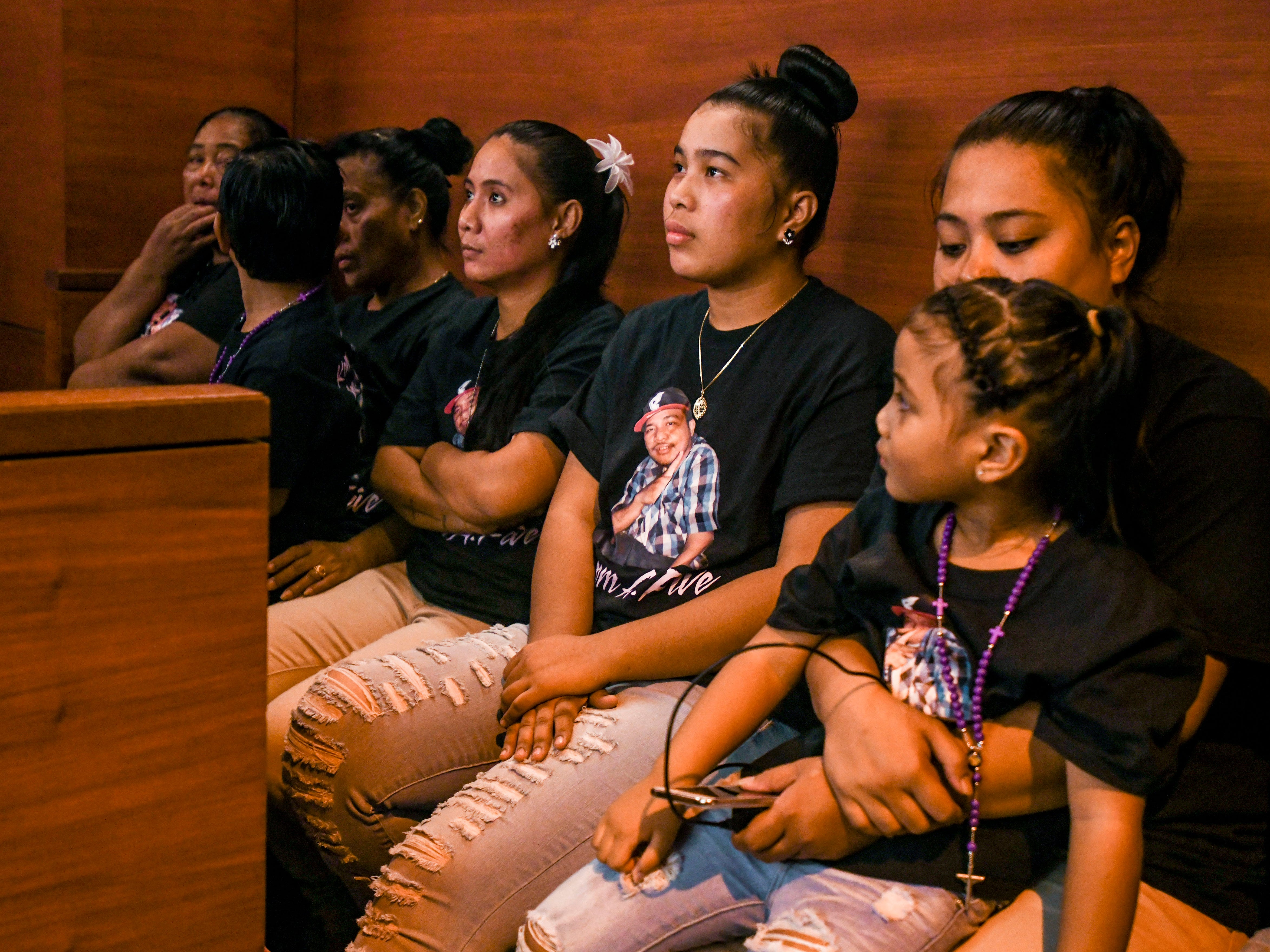 Myrose Mwarecheong, center, wife of shooting victim AV Mwarecheong, her children, family members and others, attend the change of plead hearing for defeandant, Joseph Sagdal, at the  Superior Court of Guam in Hagågtña on Thursday, Dec. 6, 2018. Sagdal faced charges in the December 2017 shooting deaths of Brokey Thamaso and AV Mwarecheong. During the hearing, Sagdal pleaded guilty to one count of manslaughter for the death of Mwarecheong and was sentenced to 15 years, with six years of his sentence suspended, by Judge Cenzon.
