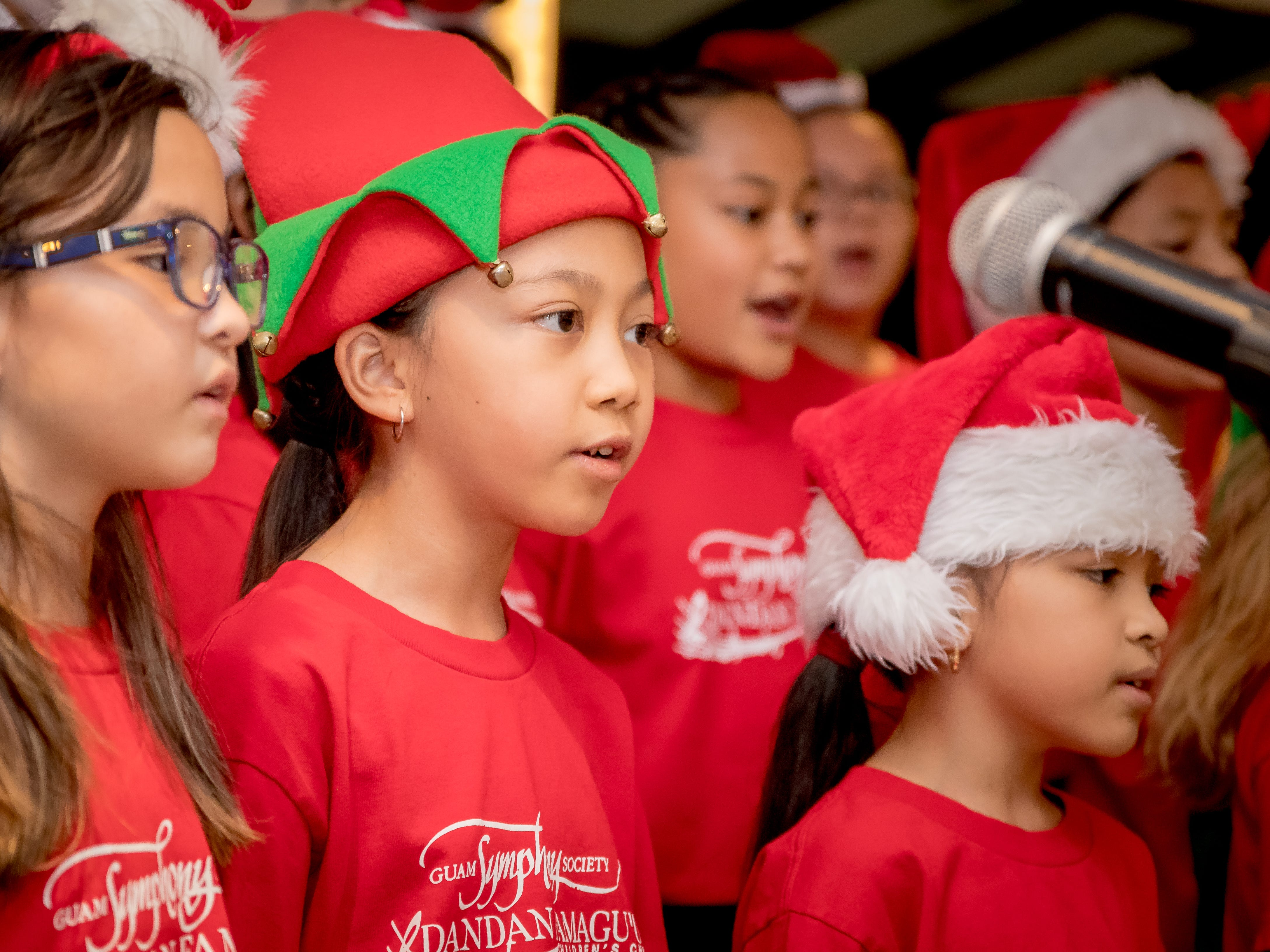 "The Guam Symphony Society Children's Choir peforms Christmas carols during Hilton Guam Resort and Spa's ""Holiday Train"" kick-off on Dec. 5."