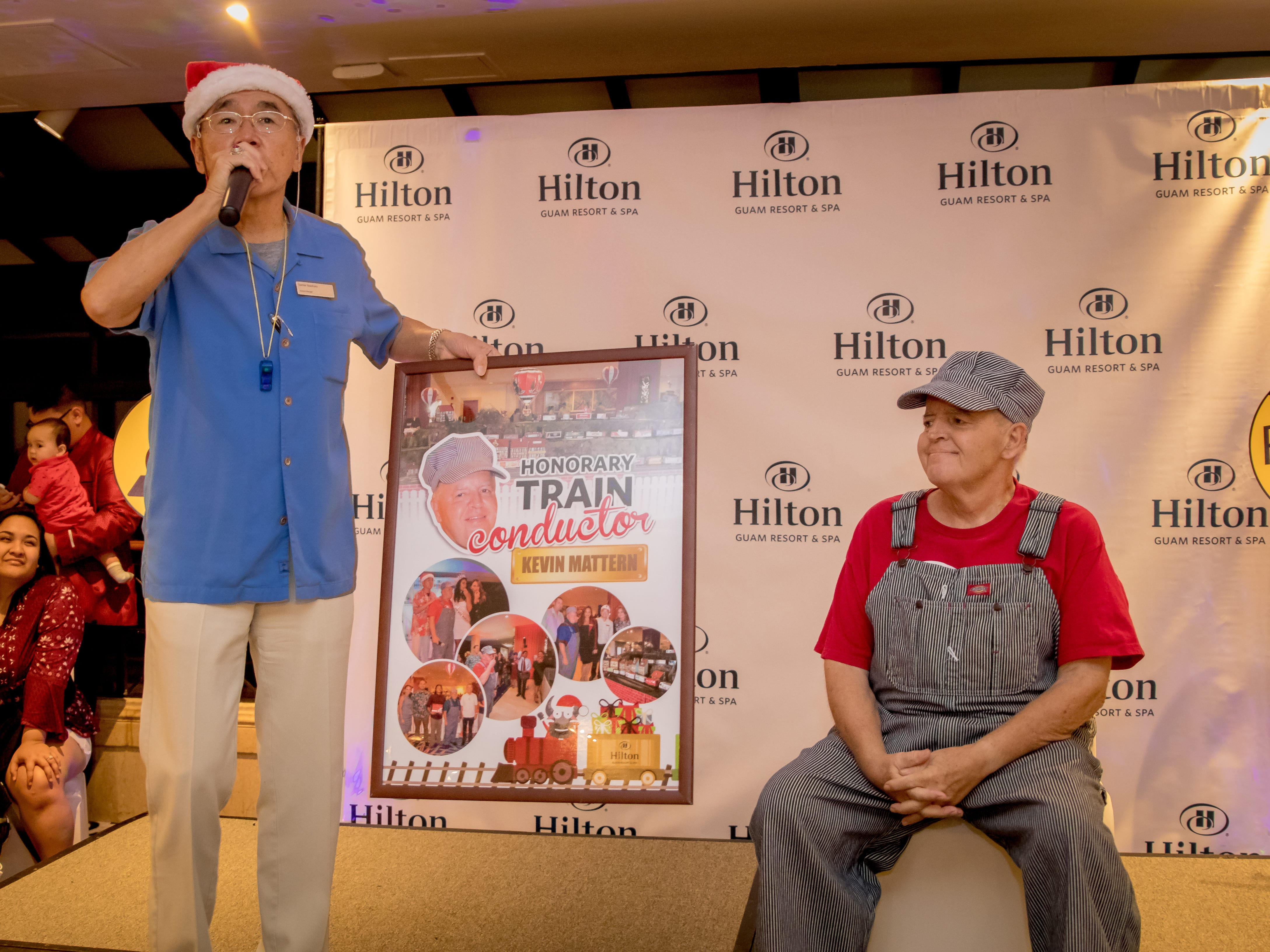 Kevin Mattern of Hilton Guam Resort and Spa Engineering Department is recognize as the Honorary Train Conductor.