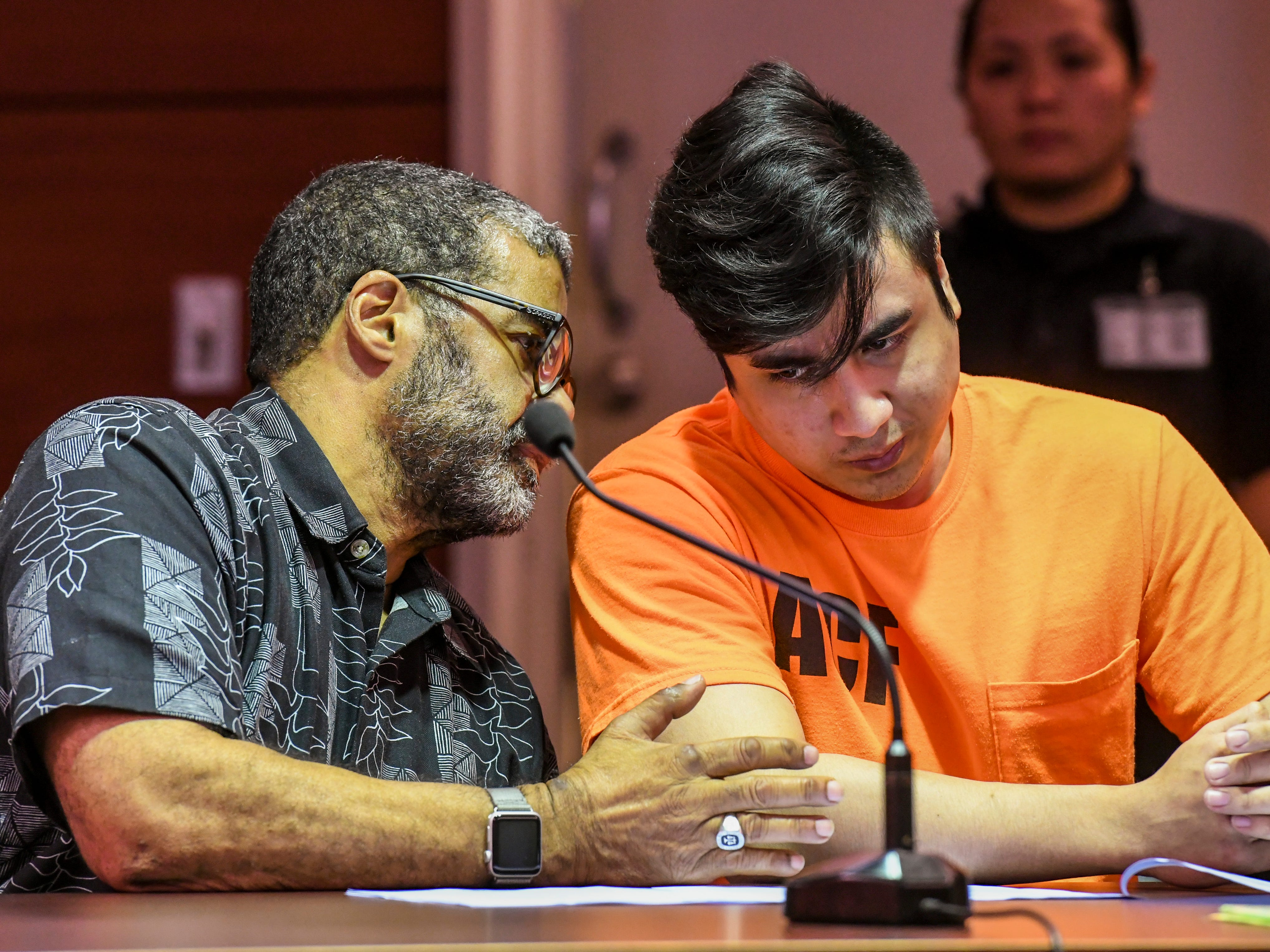 Defendant Joseph Sagdal, right, listens to advice by his attorney, Clyde Lemons Jr., during his appearance before Superior Court of Guam Judge Maria Cenzon in Hagågtña on Thursday, Dec. 6, 2018. Sagdal faced charges in the December 2017 shooting deaths of Brokey Thamaso and AV Mwarecheong. During the hearing, Sagdal pleaded guilty to one count of manslaughter for the death of Mwarecheong and was sentenced to 15 years, with six years of his sentence suspended, by Judge Cenzon.