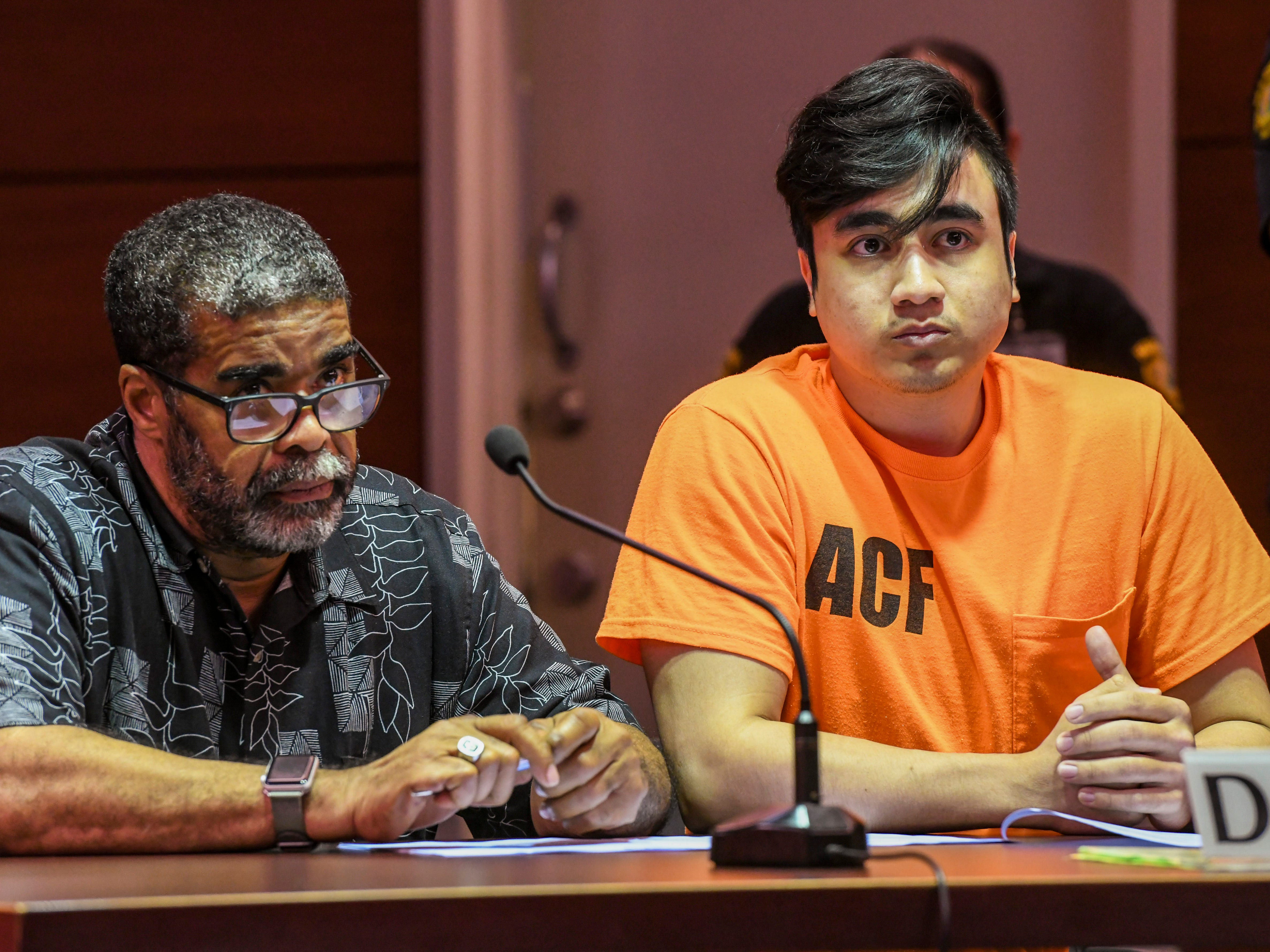 Defendant Joseph Sagdal, right, is seated with his attorney, Clyde Lemons Jr., as they listen to remarks made by the prosecution during his appearance before Superior Court of Guam Judge Maria Cenzon in Hagåtña on Thursday, Dec. 6, 2018. Sagdal faced charges in the December 2017 shooting deaths of Brokey Thamaso and AV Mwarecheong. During the hearing, Sagdal pleaded guilty to one count of manslaughter for the death of Mwarecheong and was sentenced to 15 years, with six years of his sentence suspended, by Judge Cenzon.