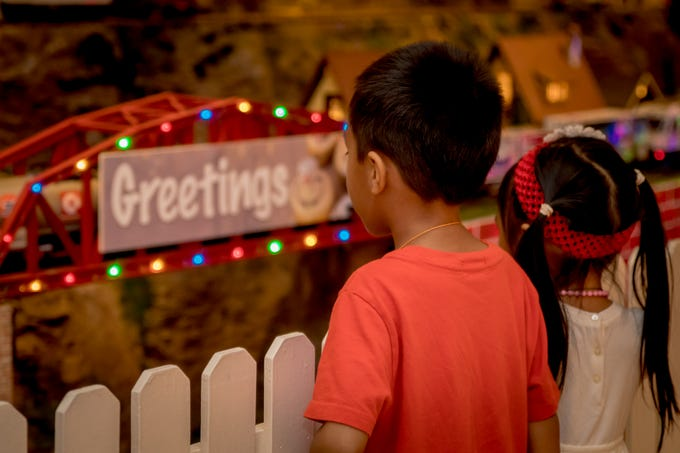 """Hilton Guam Resort and Spa transforms their lobby displaying train sets, miniature local sites, train landscapes, and advertising from local companies.  Sponsorship at the """"Holiday Train"""" benefits a local charity Victim Advocates Reaching Out."""