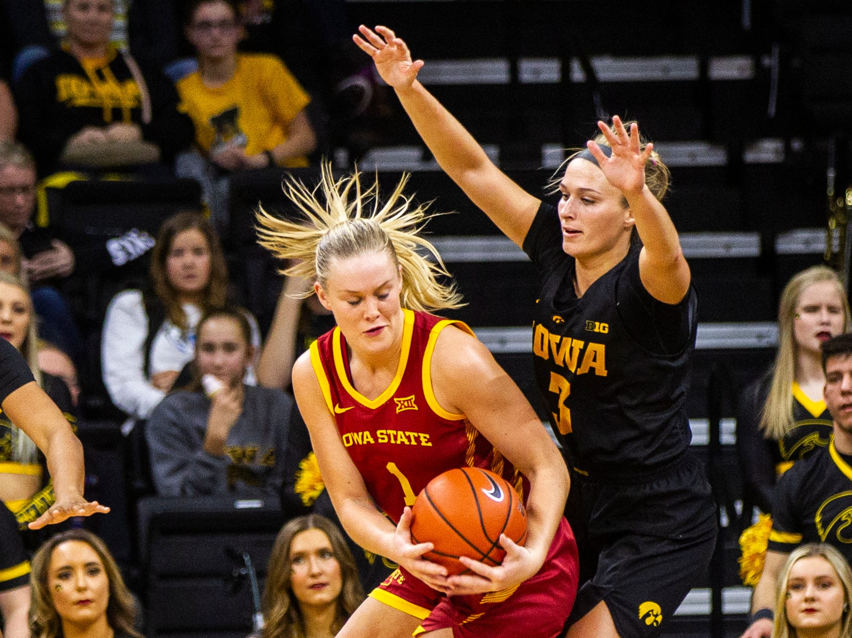 Iowa State forward Madison Wise (1) gets defended by Iowa guard Makenzie Meyer (3) during a Cy-Hawk series NCAA women's basketball game on Wednesday, Dec. 5, 2018, at Carver-Hawkeye Arena in Iowa City.