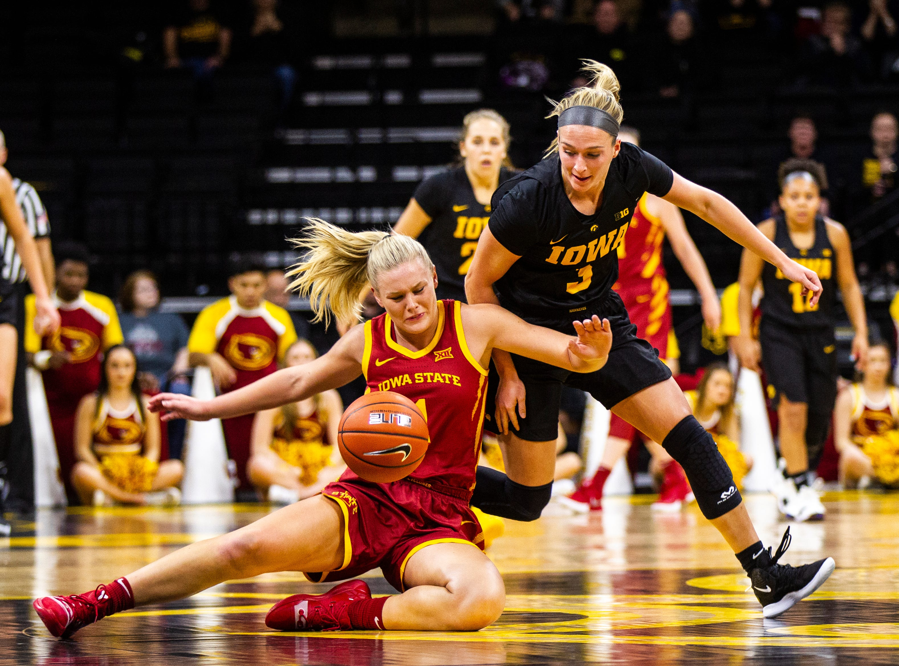 Iowa State forward Madison Wise (1) and Iowa guard Makenzie Meyer (3) wrestle for a loose ball during a Cy-Hawk series NCAA women's basketball game on Wednesday, Dec. 5, 2018, at Carver-Hawkeye Arena in Iowa City.