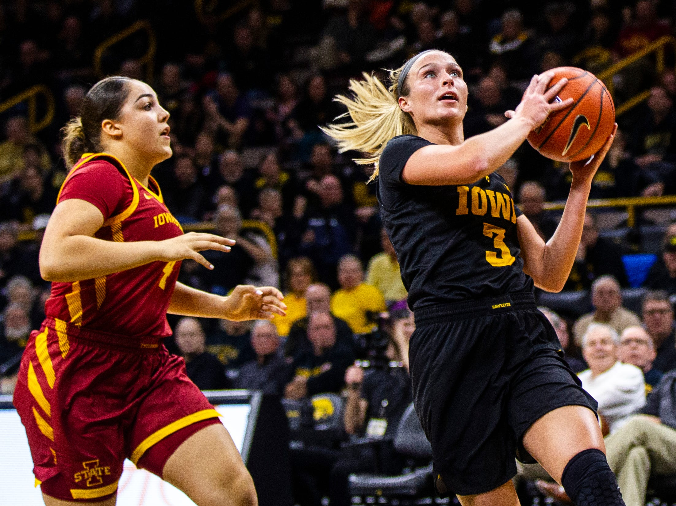 Iowa guard Makenzie Meyer (3) attempts a layup during a Cy-Hawk series NCAA women's basketball game on Wednesday, Dec. 5, 2018, at Carver-Hawkeye Arena in Iowa City.