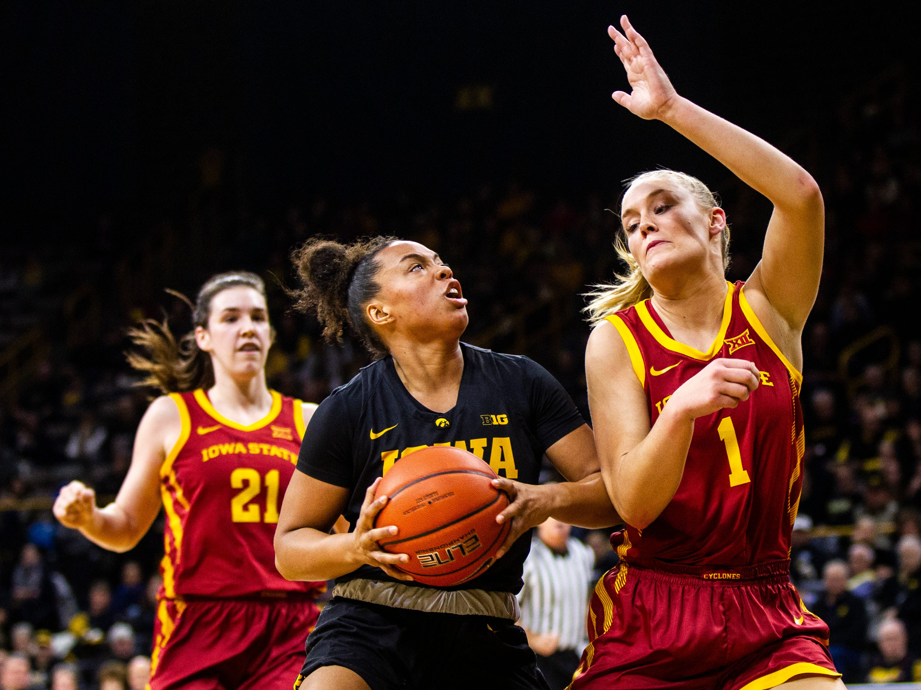 Iowa guard Alexis Sevillian (5) drives to the basket past Iowa State forward Madison Wise (1) during a Cy-Hawk series NCAA women's basketball game on Wednesday, Dec. 5, 2018, at Carver-Hawkeye Arena in Iowa City.
