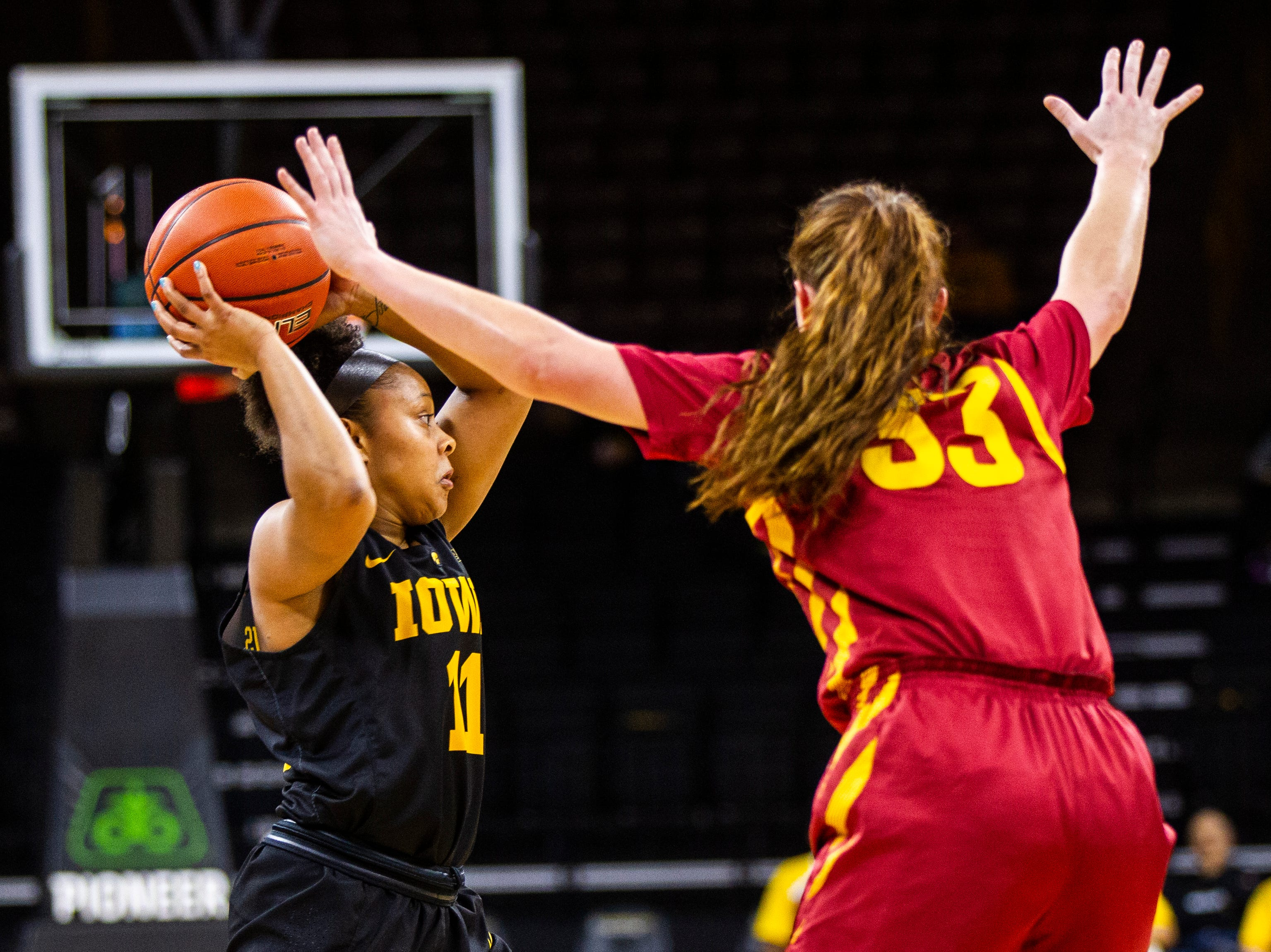 Iowa guard Tania Davis (11) passes during a Cy-Hawk series NCAA women's basketball game on Wednesday, Dec. 5, 2018, at Carver-Hawkeye Arena in Iowa City.