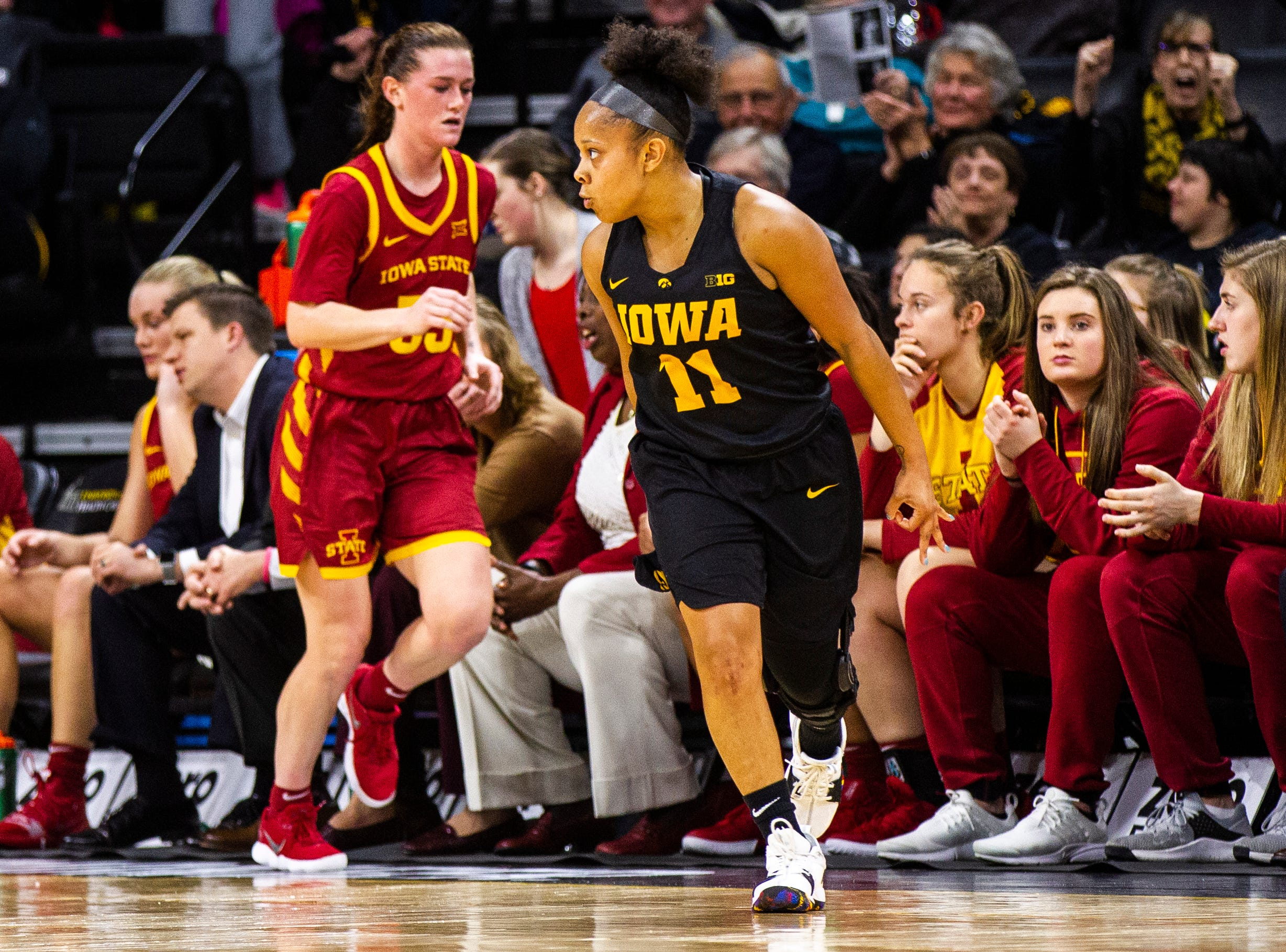 Iowa guard Tania Davis (11) celebrates after making a 3-point basket during a Cy-Hawk series NCAA women's basketball game on Wednesday, Dec. 5, 2018, at Carver-Hawkeye Arena in Iowa City.