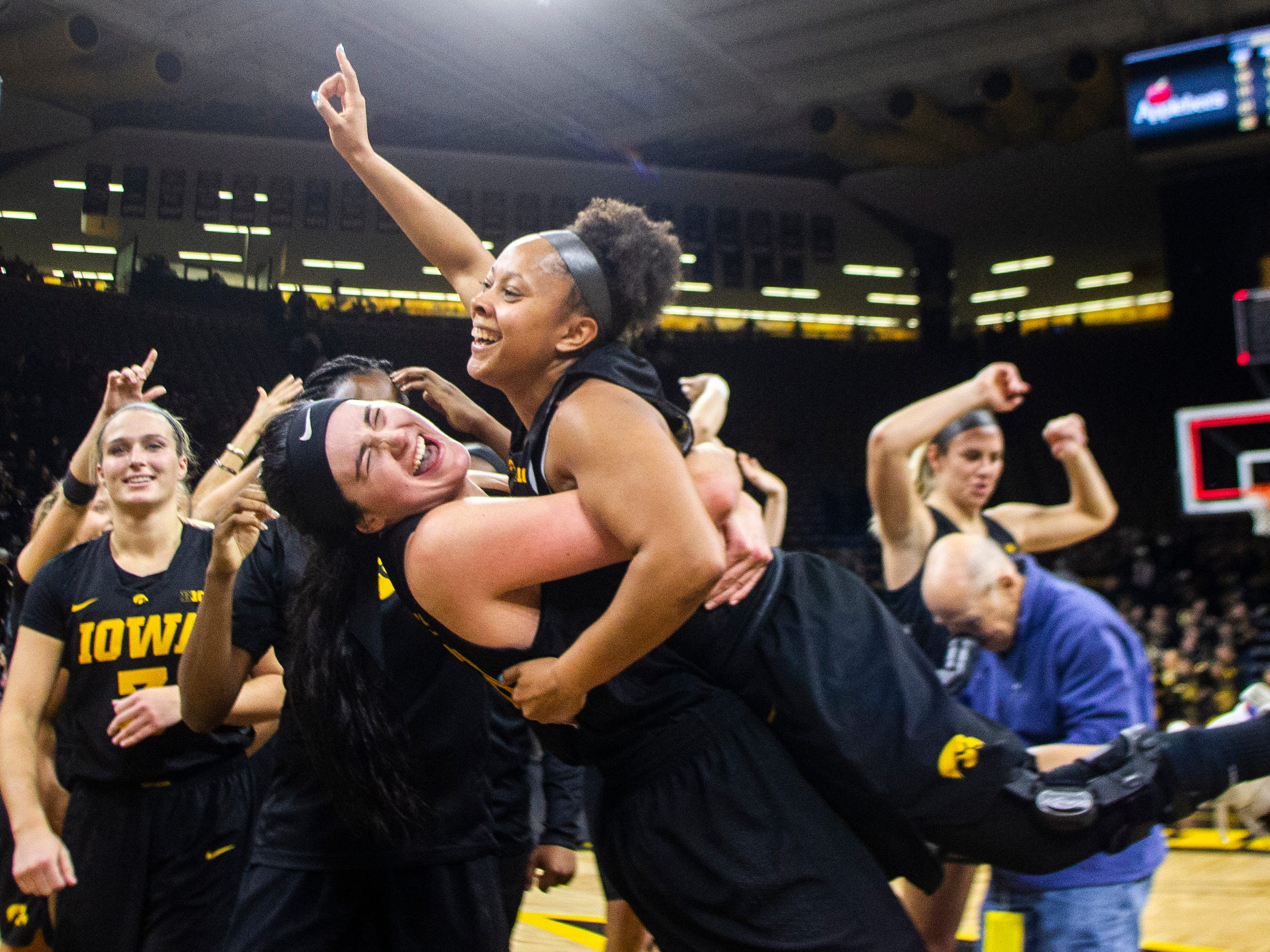 Iowa forward Megan Gustafson (10) embraces Iowa guard Tania Davis (11) after a Cy-Hawk series NCAA women's basketball game on Wednesday, Dec. 5, 2018, at Carver-Hawkeye Arena in Iowa City. The Hawkeyes defeated the Cyclones, 73-70.