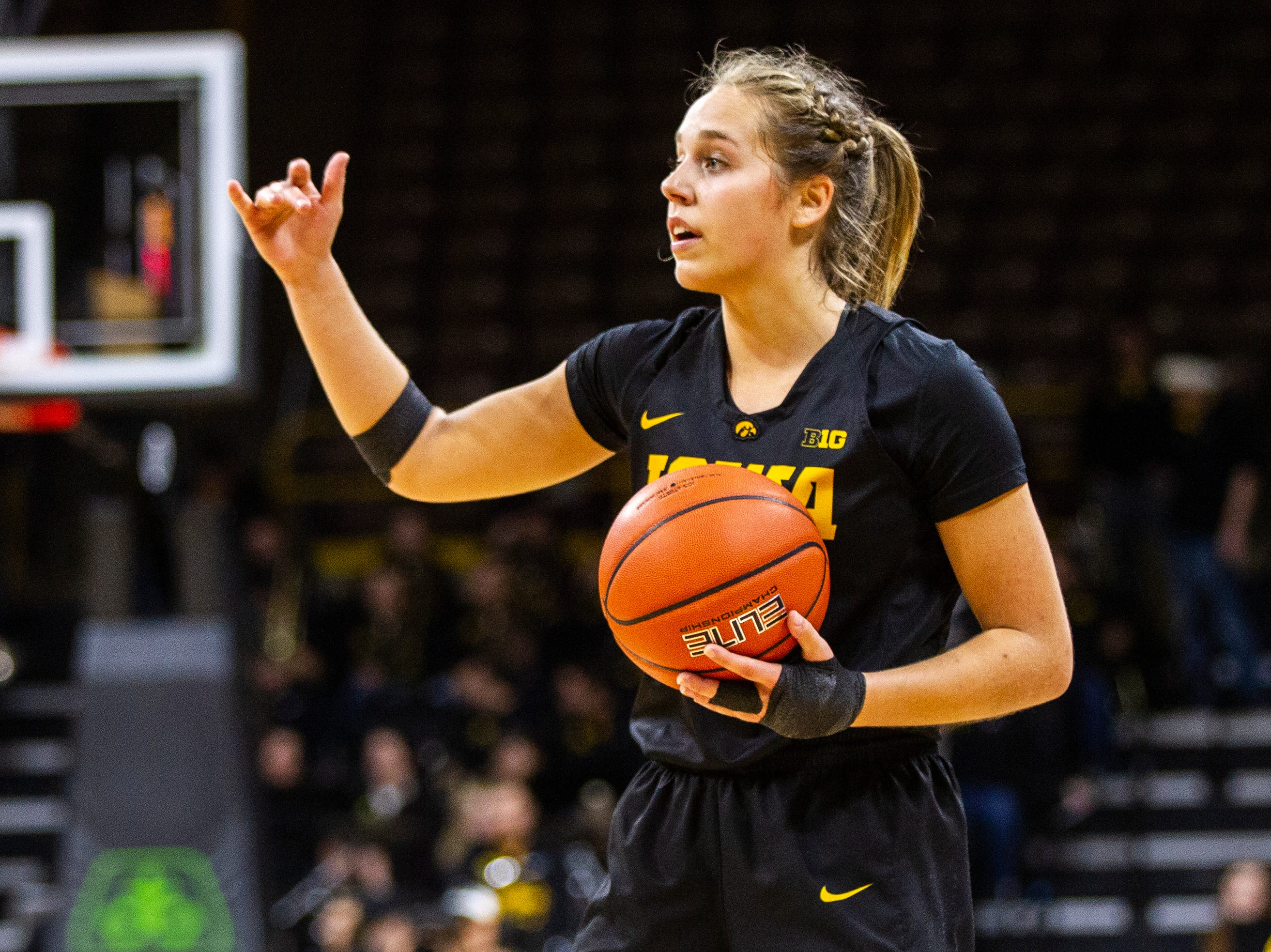 Iowa guard Kathleen Doyle calls out to teammates during a Cy-Hawk series NCAA women's basketball game on Wednesday, Dec. 5, 2018, at Carver-Hawkeye Arena in Iowa City.