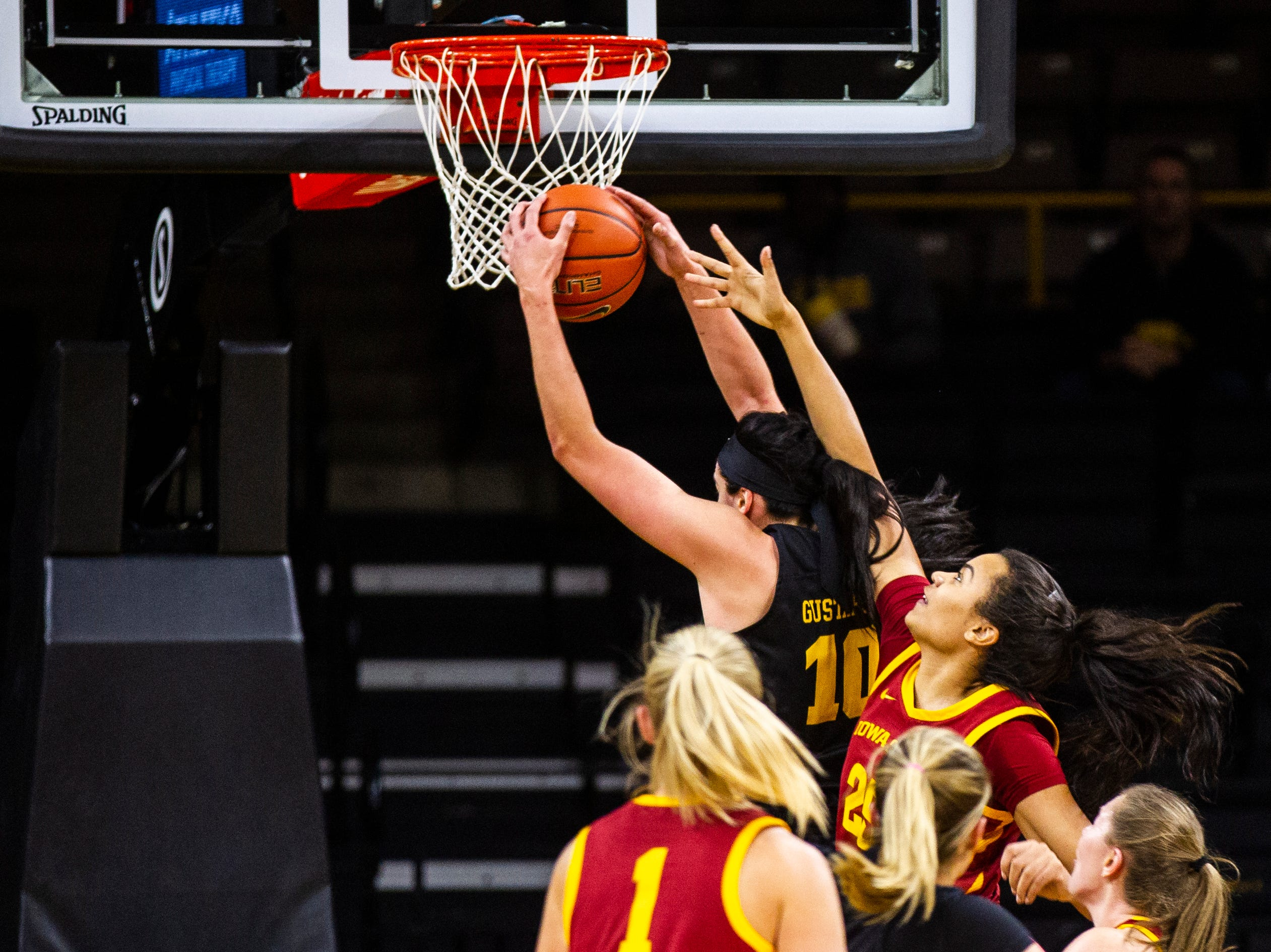 Iowa forward Megan Gustafson (10) grabs a rebound to break the school record during a Cy-Hawk series NCAA women's basketball game on Wednesday, Dec. 5, 2018, at Carver-Hawkeye Arena in Iowa City.