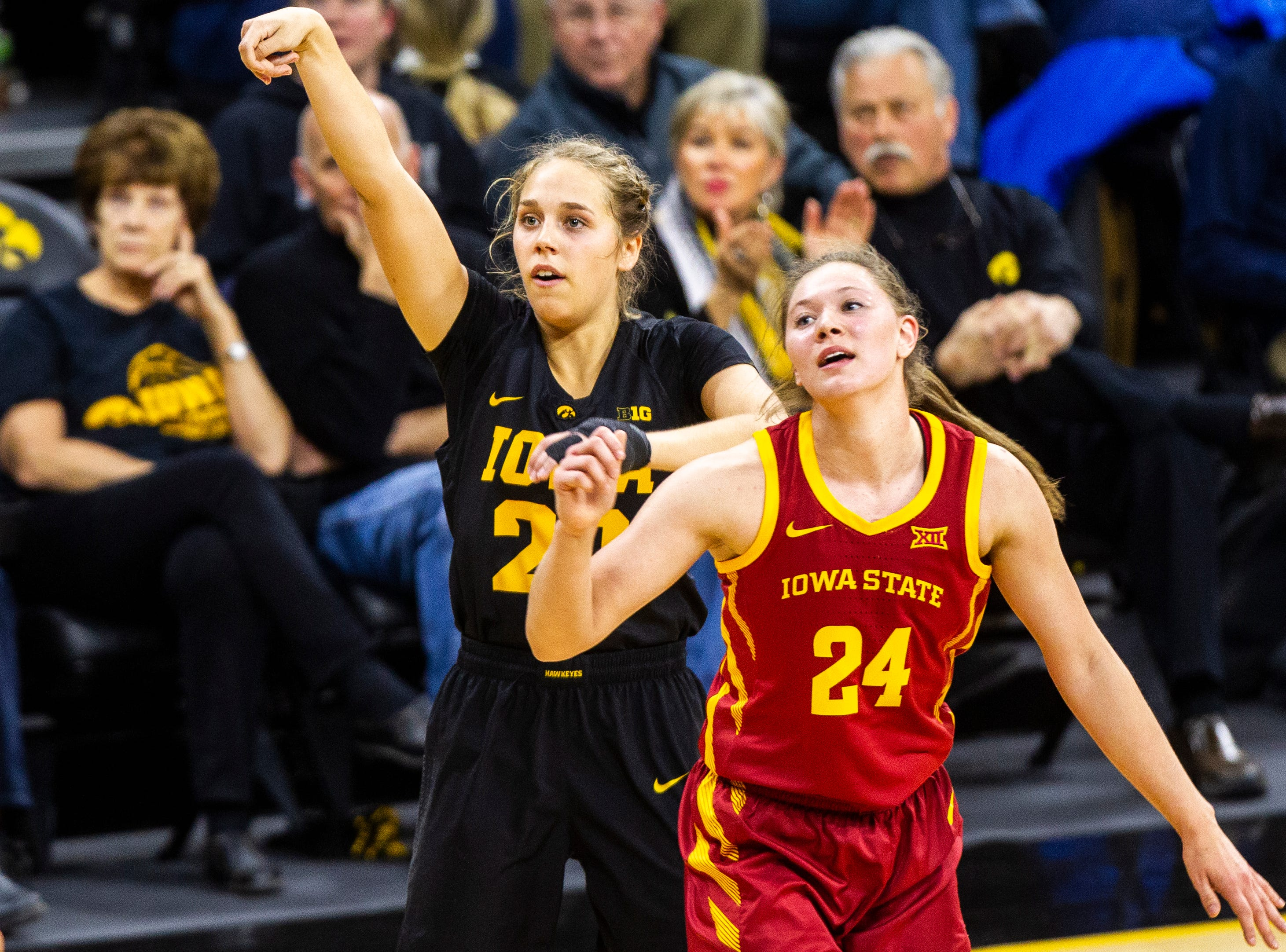 Iowa guard Kathleen Doyle (22) watches as her 3-point basket lands while being defended by Iowa State guard Ashley Joens (24) during a Cy-Hawk series NCAA women's basketball game on Wednesday, Dec. 5, 2018, at Carver-Hawkeye Arena in Iowa City.