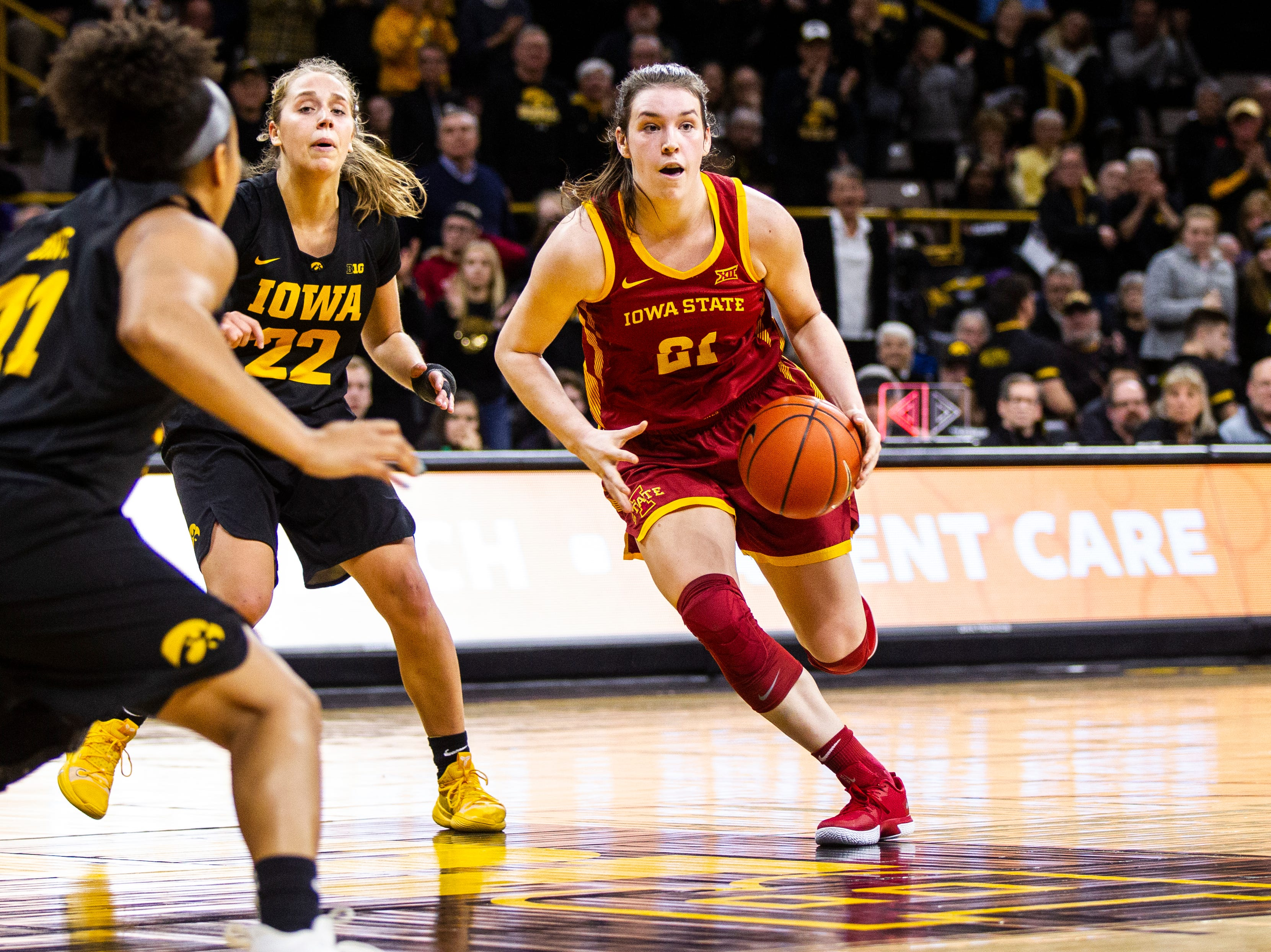 Iowa State guard Bridget Carleton (21) drives in the paint past Iowa guard Kathleen Doyle (22) during a Cy-Hawk series NCAA women's basketball game on Wednesday, Dec. 5, 2018, at Carver-Hawkeye Arena in Iowa City.