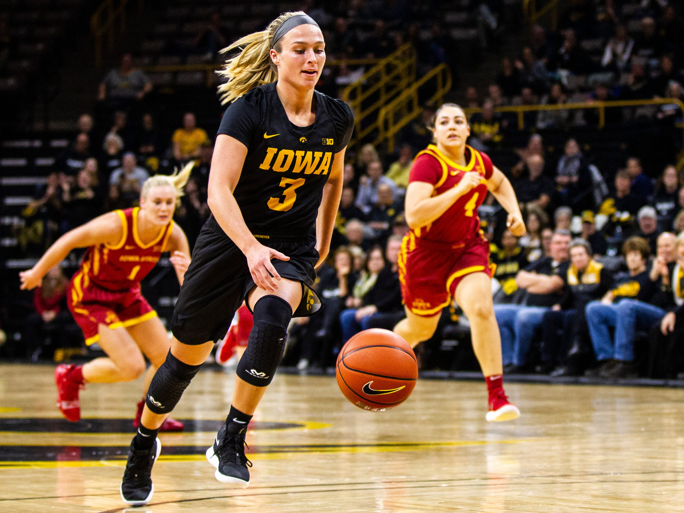 Iowa guard Makenzie Meyer (3) drives to the basket after getting a steal during a Cy-Hawk series NCAA women's basketball game on Wednesday, Dec. 5, 2018, at Carver-Hawkeye Arena in Iowa City.