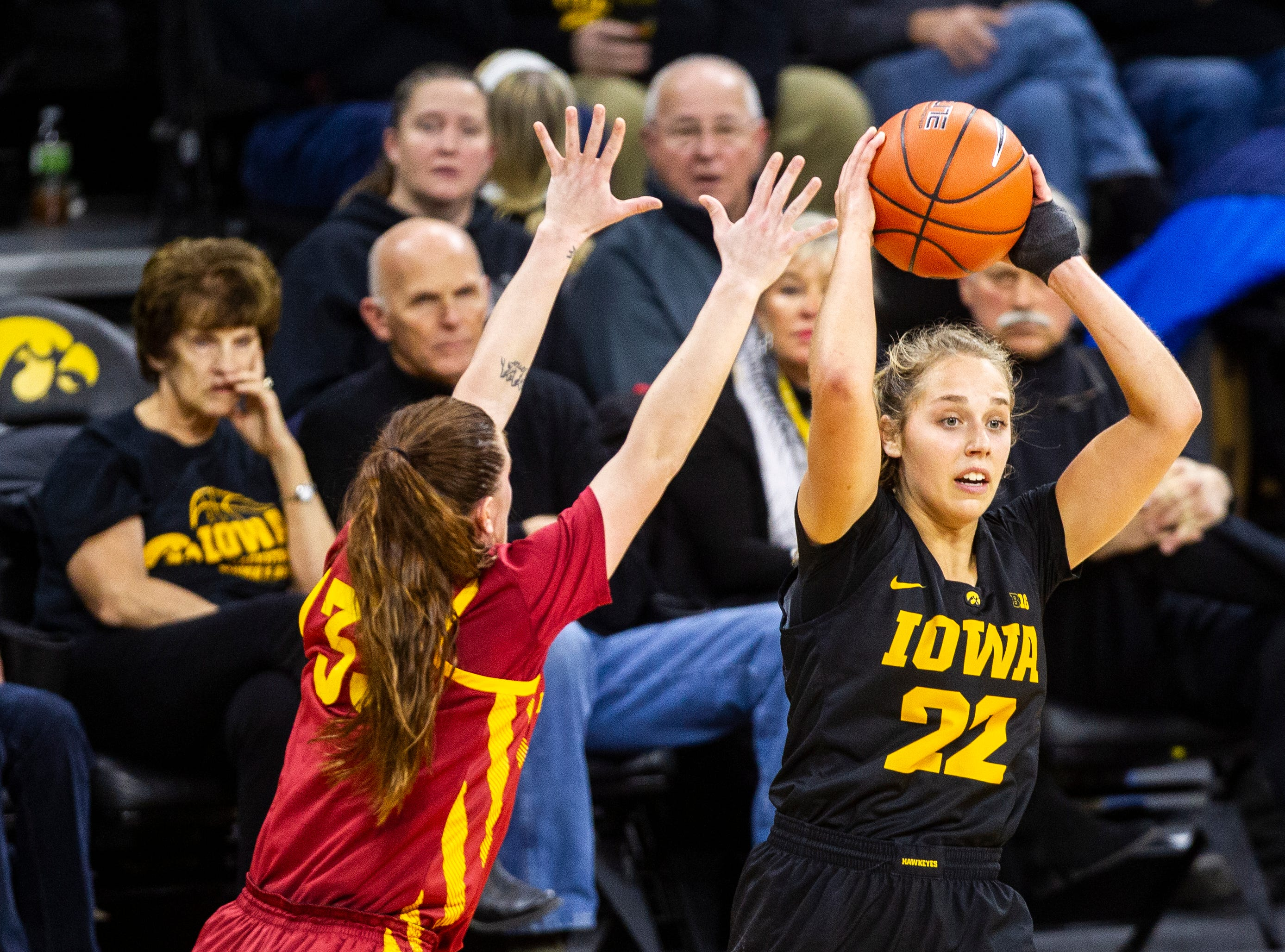 Iowa guard Kathleen Doyle (22) looks to pass during a Cy-Hawk series NCAA women's basketball game on Wednesday, Dec. 5, 2018, at Carver-Hawkeye Arena in Iowa City.