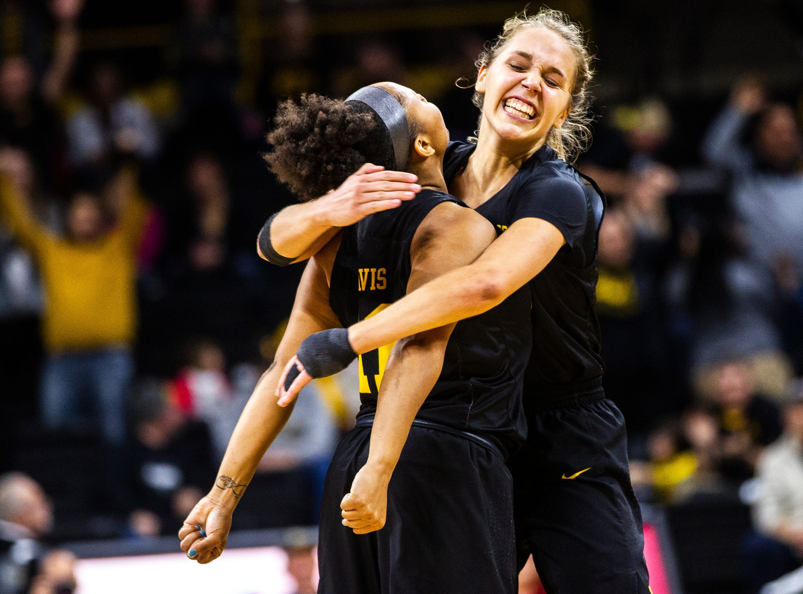 Iowa guard Kathleen Doyle (right) embraces Iowa guard Tania Davis after she made a 3-point basket during a Cy-Hawk series NCAA women's basketball game on Wednesday, Dec. 5, 2018, at Carver-Hawkeye Arena in Iowa City.