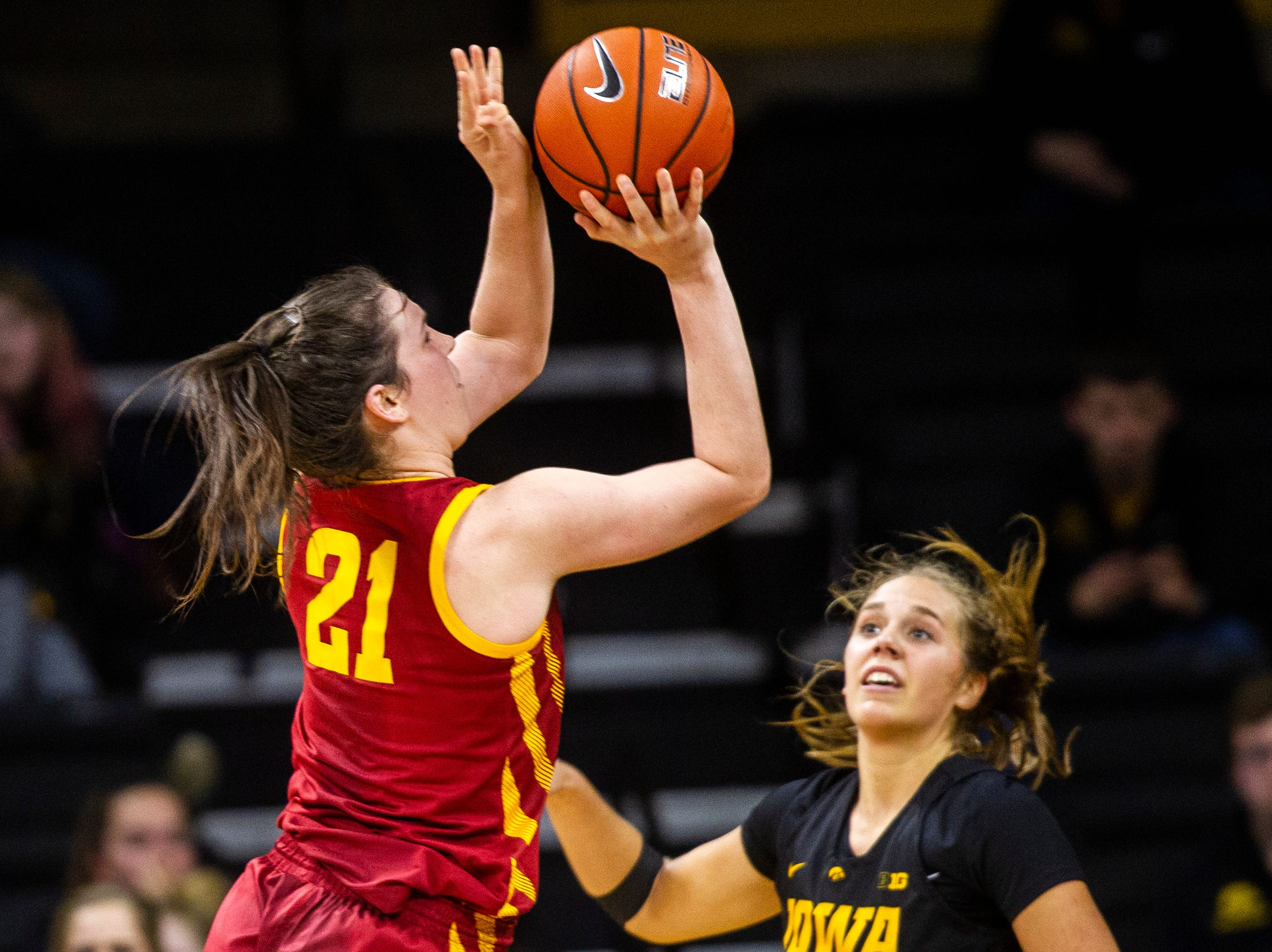 Iowa State guard Bridget Carleton (21) attempts a basket past Iowa guard Kathleen Doyle during a Cy-Hawk series NCAA women's basketball game on Wednesday, Dec. 5, 2018, at Carver-Hawkeye Arena in Iowa City.