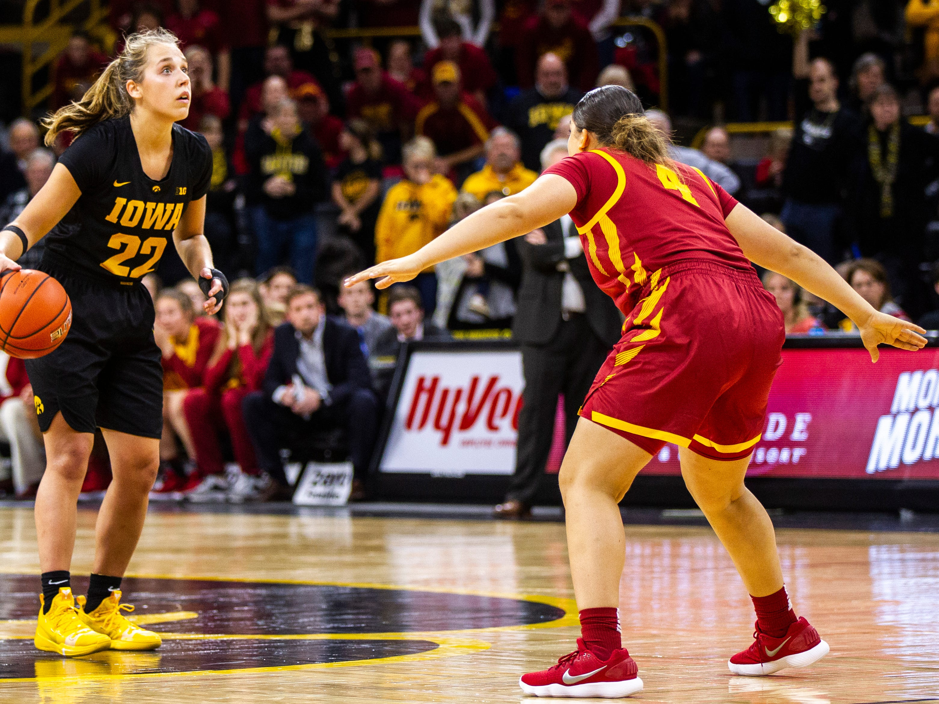 Iowa guard Kathleen Doyle (22) looks up to the shot clock while time expires during a Cy-Hawk series NCAA women's basketball game on Wednesday, Dec. 5, 2018, at Carver-Hawkeye Arena in Iowa City.