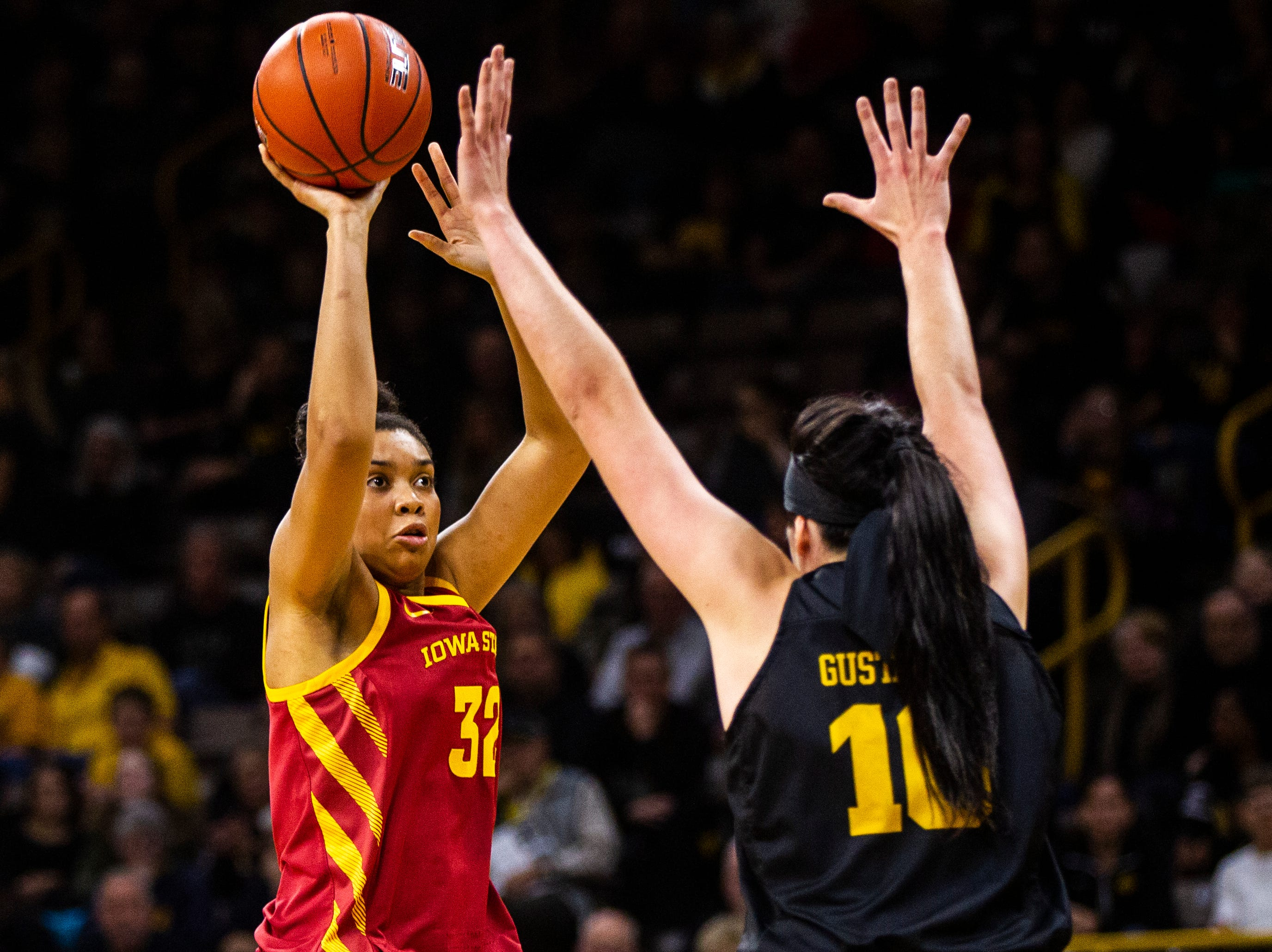 Iowa State forward Meredith Burkhall (32) shoots a 3-point basket past Iowa forward Megan Gustafson (10) during a Cy-Hawk series NCAA women's basketball game on Wednesday, Dec. 5, 2018, at Carver-Hawkeye Arena in Iowa City.
