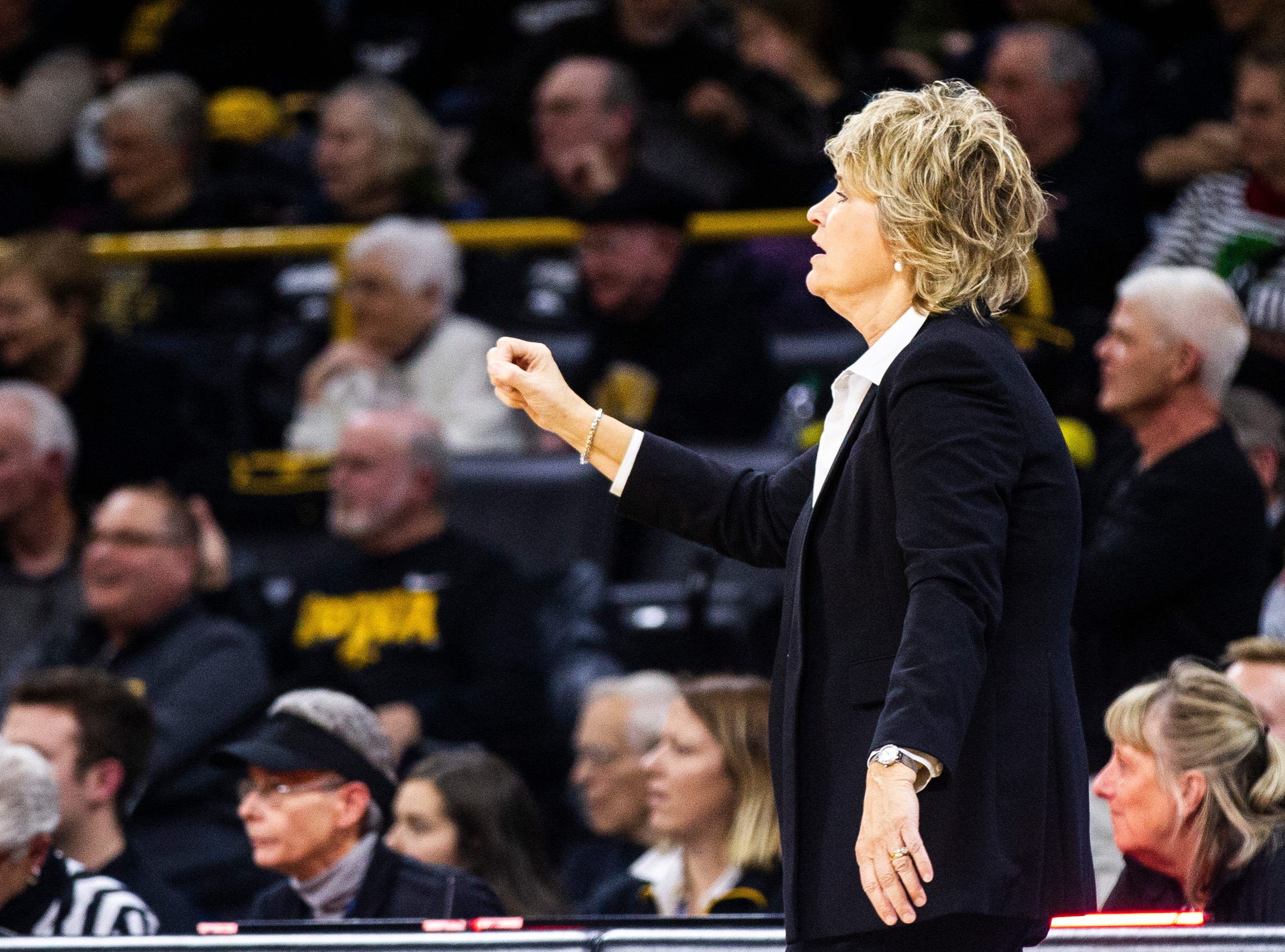 Iowa head coach Lisa Bluder calls out to players during a Cy-Hawk series NCAA women's basketball game on Wednesday, Dec. 5, 2018, at Carver-Hawkeye Arena in Iowa City.