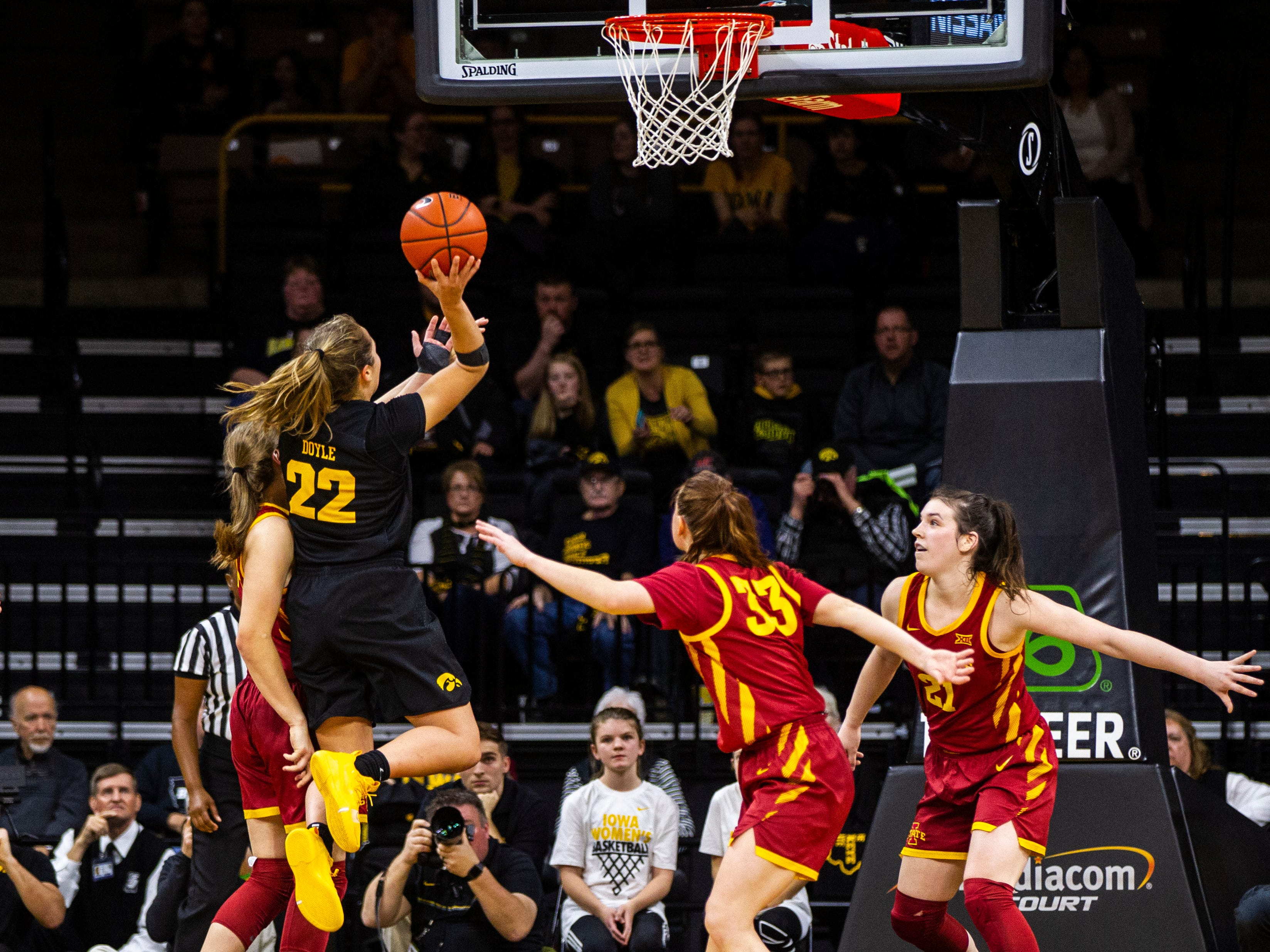Iowa guard Kathleen Doyle (22) attempts a basket during a Cy-Hawk series NCAA women's basketball game on Wednesday, Dec. 5, 2018, at Carver-Hawkeye Arena in Iowa City.