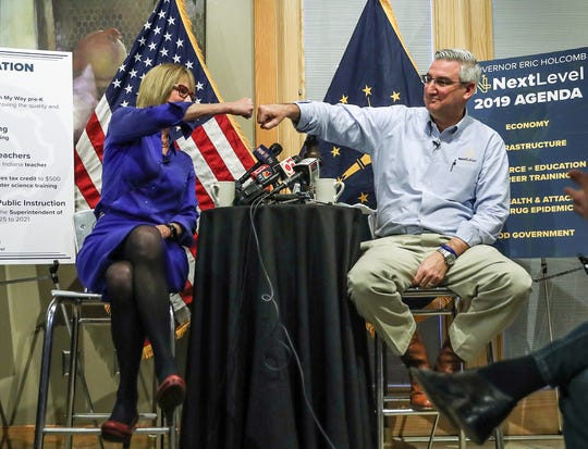 Gov. Eric Holcomb and Lt. Gov. Suzanne Crouch bump fists before outlining his 2019 agenda.