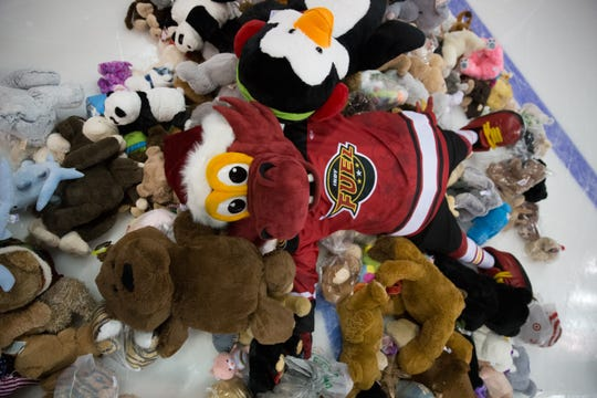 The Indy Fuel mascot enjoys a past Teddy Bear Toss.