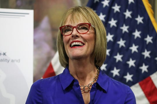 From left, Indiana Lt. Gov. Suzanne Crouch greets the crowd before Gov. Eric Holcomb shared items on the state's 2019 legislative agenda at Trader's Point Creamery in Zionsville, Ind., Thursday, Dec. 6, 2018.