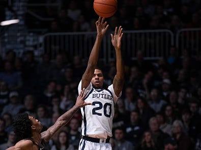 INDIANAPOLIS, IN - DECEMBER 05: Butler Bulldogs guard HenryBaddley (20) hits a three pointer from the corner during the men's college basketball game between the Butler Bulldogs and Brown Bears on December 5, 2018, at Hinkle Fieldhouse in Indianapolis, IN.