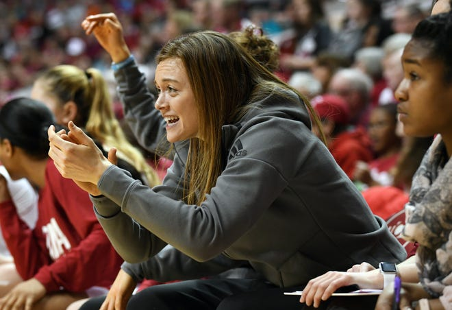 Indiana Hoosiers forward Brenna Wise (50) cheers on the women's team last season. She led the IU women's team to victory on Dec. 5, 2018, against Butler.