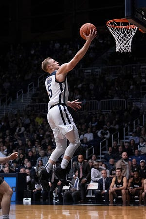 INDIANAPOLIS, IN - DECEMBER 05: Butler Bulldogs guard Paul  Jorgensen (5) goes in for a fast break layup after a steal during the men's college basketball game between the Butler Bulldogs and Brown Bears on December 5, 2018, at Hinkle Fieldhouse in Indianapolis, IN.