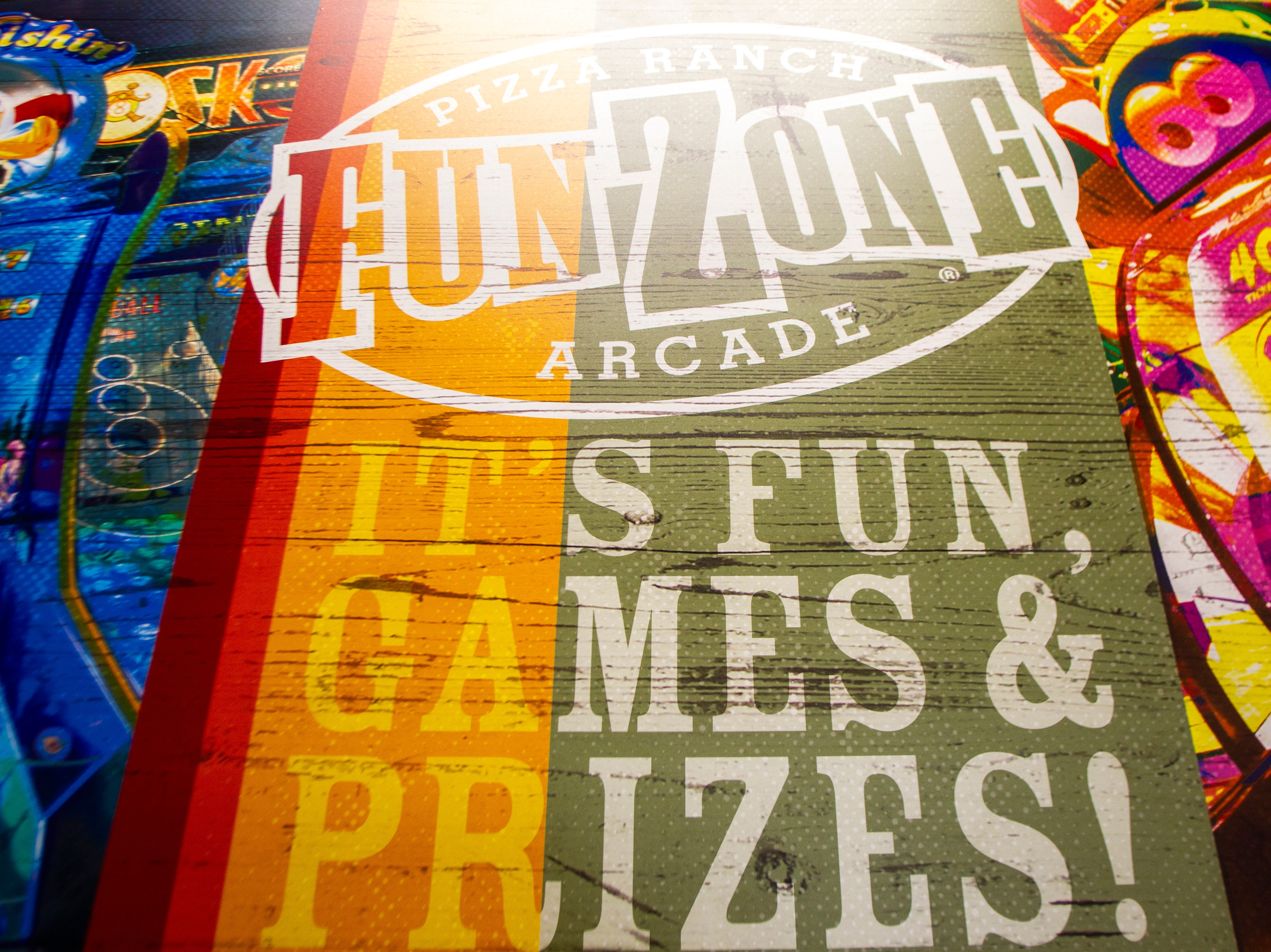 "A sign hangs in a hallway for the ""Fun Zone Arcade"" during a soft opening event on Thursday, Dec. 6, 2018, at Pizza Ranch on Highway 1 West in Iowa City."