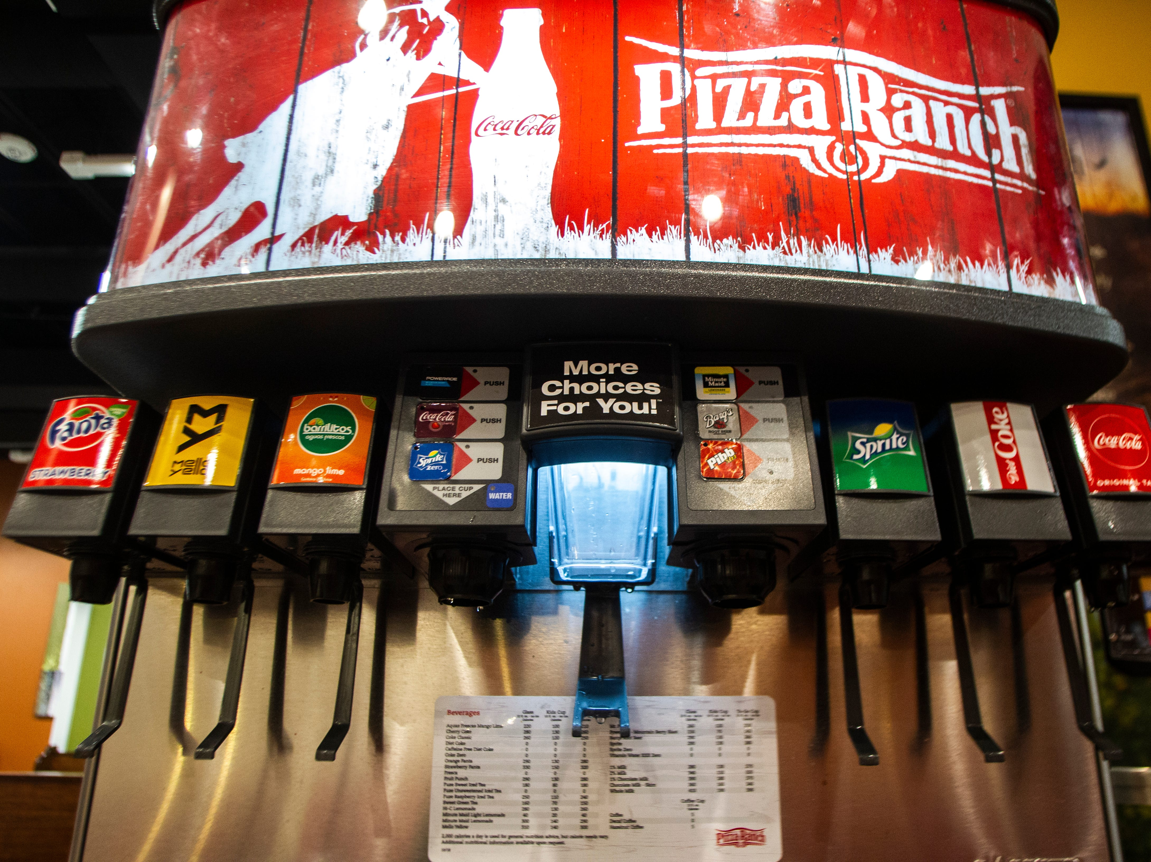 A Pizza Ranch branded Coca-Cola machine is seen during a soft opening event on Thursday, Dec. 6, 2018, at Pizza Ranch on Highway 1 West in Iowa City.
