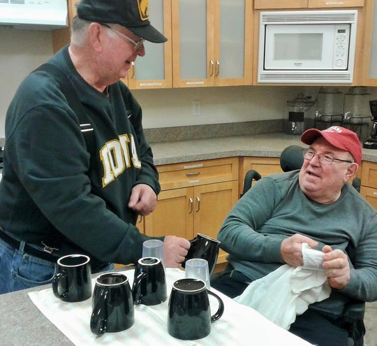 """The kitchen crew consists of Bill Nehring (left) and Rad Fish, shown here drying cups and glasses.  The """"Premise Keepers"""" have a nearly ten-year history of voluntarily cleaning Holy Trinity Lutheran Church every week."""